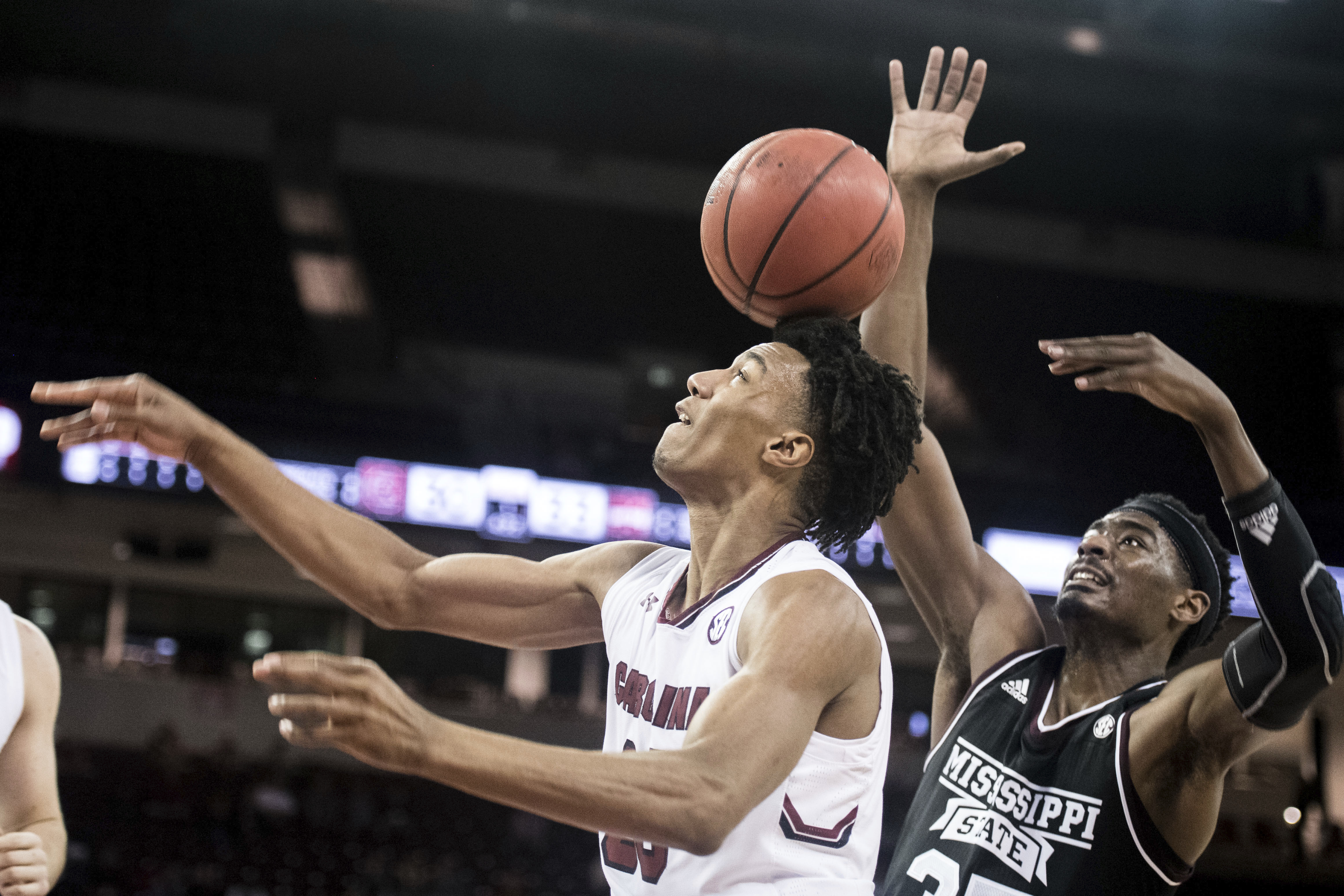 South Carolina guard A.J. Lawson, left, has a shot blocked by Mississippi State forward Aric Holman (35) during the first half of an NCAA college basketball game Tuesday, Jan. 8, 2019, in Columbia, S.C. (AP Photo/Sean Rayford)