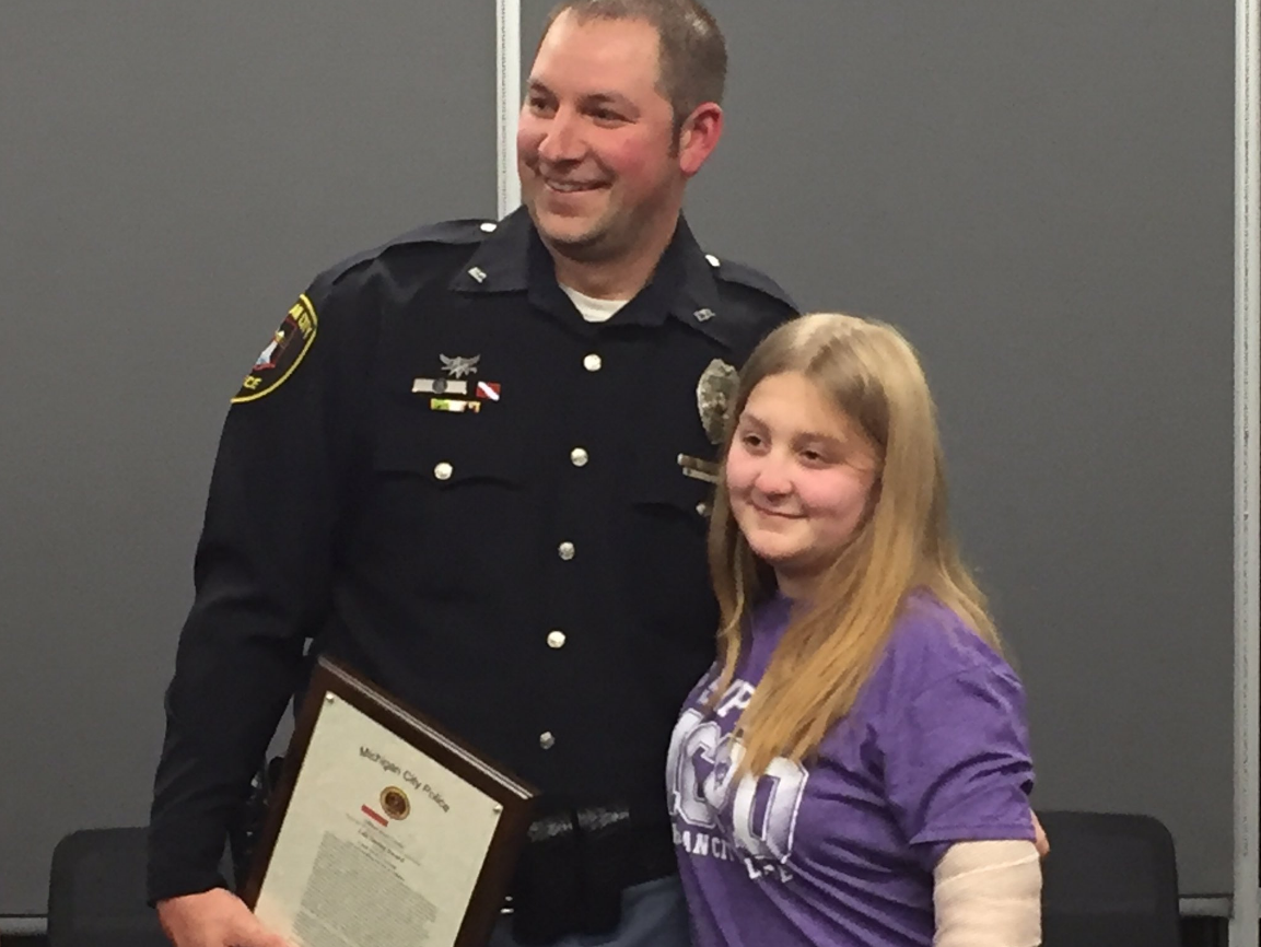 Family of 12-year-old girl thanks officer for rescuing her from dog attack. // WSBT 22