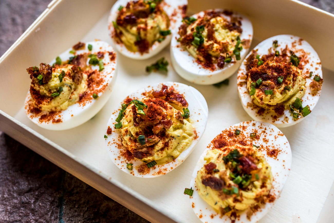 Deviled Eggs: locally sourced eggs cut in half and filled with whipped mustard, mayo, dill, and cayenne then topped with bacon and chive / Image: Catherine Viox // Published: 7.16.20