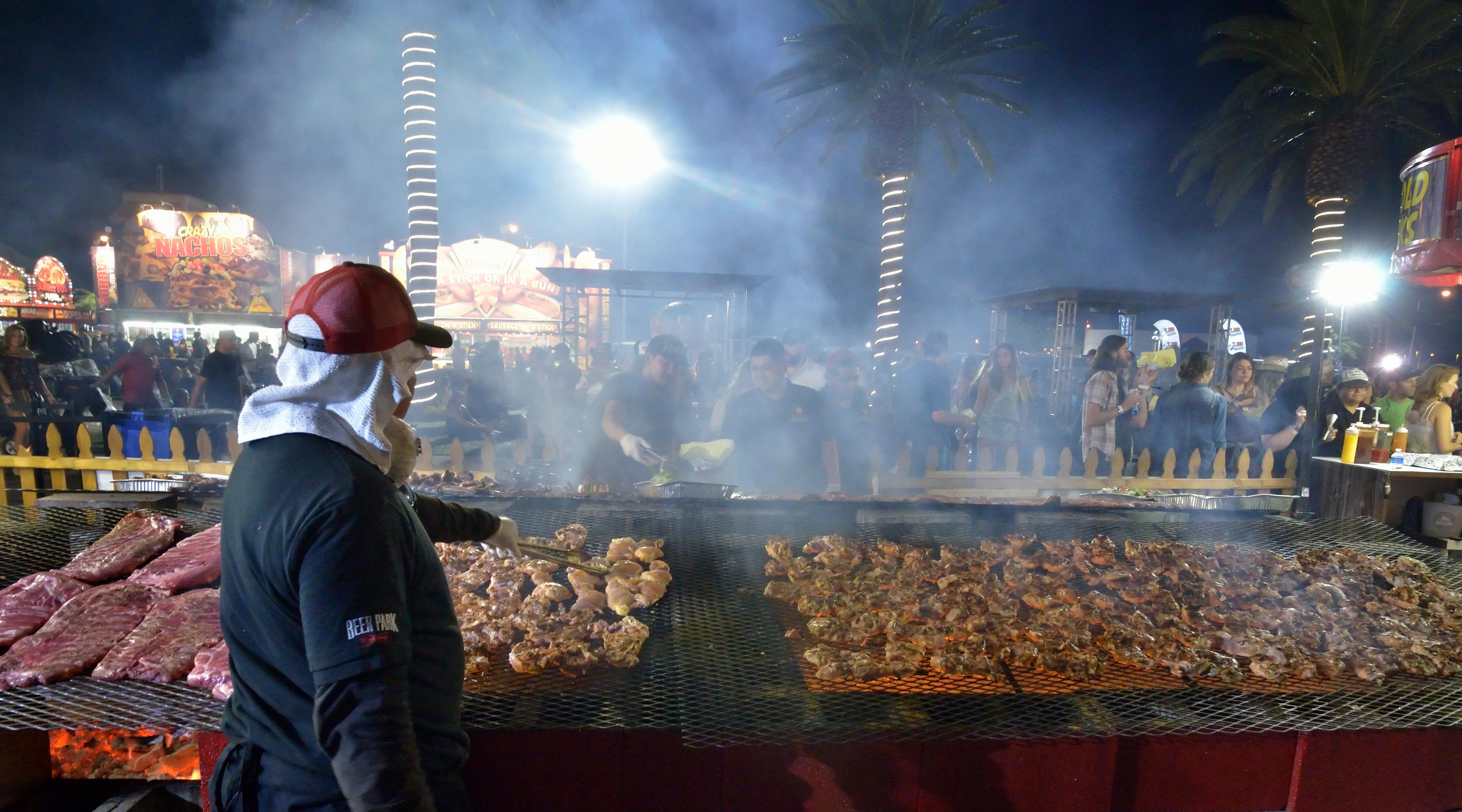 Barbecue is prepared at the Harvest Market during the Route 91 Harvest festival on Las Vegas Boulevard South in Las Vegas on Saturday, Sept. 30, 2017.  [Bill Hughes/Las Vegas News Bureau]