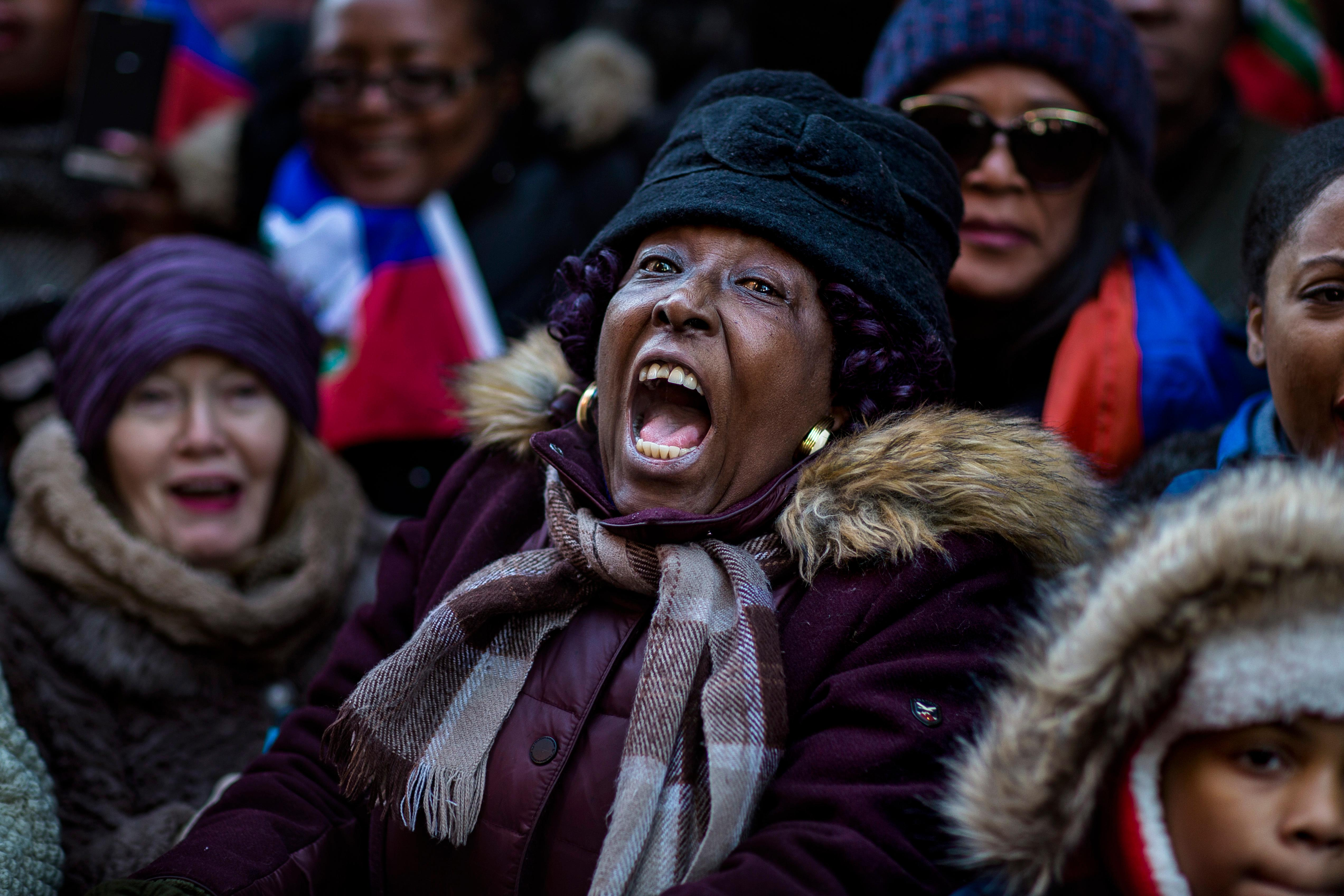 A woman shouts during a rally against racism in opposition to President Donald Trump's recent disparaging comments about Haiti and African nations in Times Square in New York, on Monday, Jan. 15, 2018. (AP Photo/Andres Kudacki)