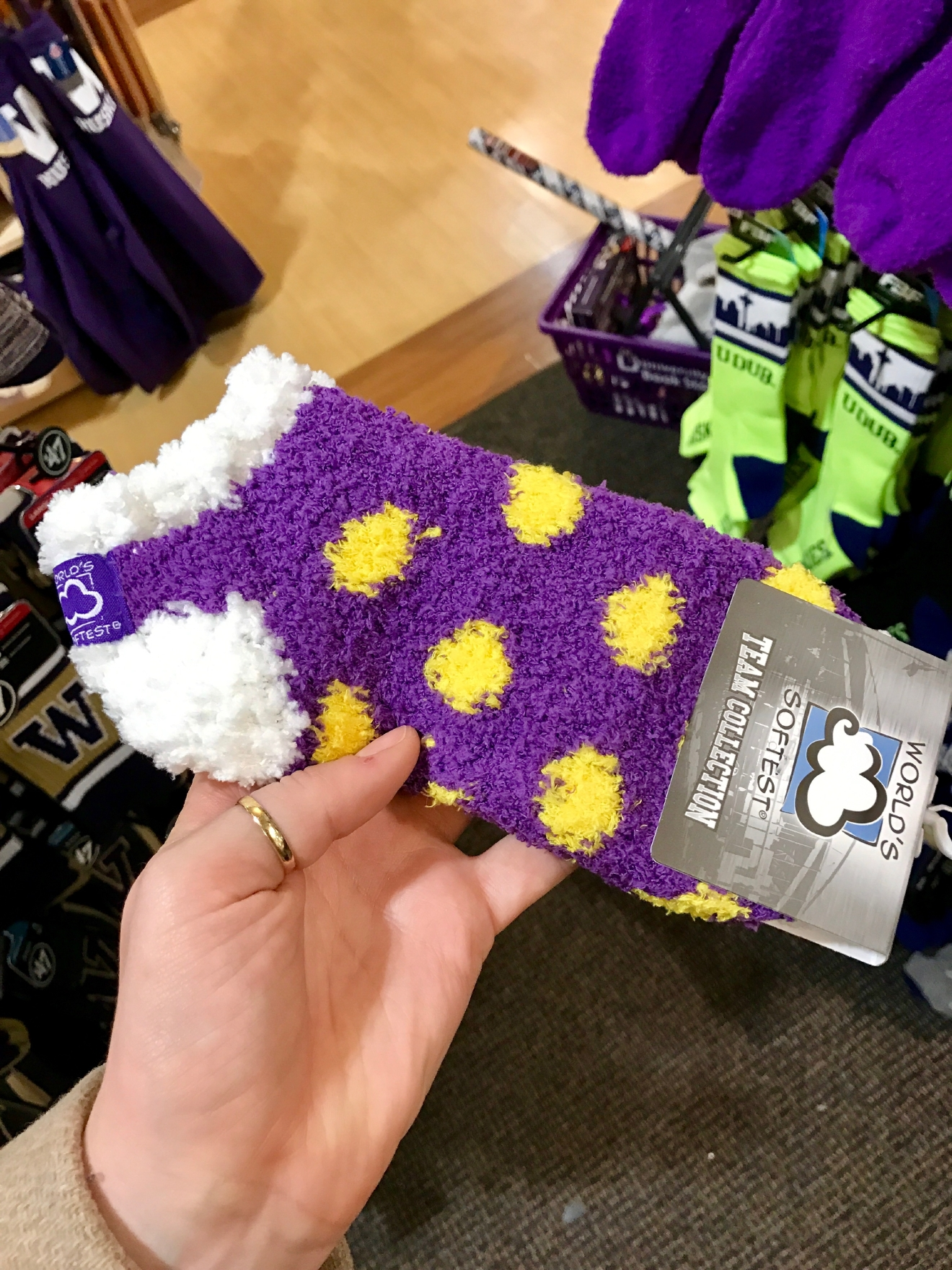 UW Fuzzy Socks - $8.95                                         Whether you're a current student, alum, or just *love* the Dawgs, it's a pretty exciting time to be a Husky fan right now. Just to catch you up, the University of Washington football team is having one of their best seasons in years, and will be playing the Peach Bowl in Atlanta on December 31st. If you know a Dawg fan, they're probably salivating at the mouth right about now. Which is why it's a perfect time to give them a themed gift! Here are some of the coolest Husky gear we saw at the University Bookstore on the Avenue during our last visit. Pro Tip: They're open 10 a.m. - 7 p.m. on Christmas Eve! (Image: Britt Thorson / Seattle Refined)