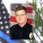 Candlelight vigil honors fallen officer 10 years after murder