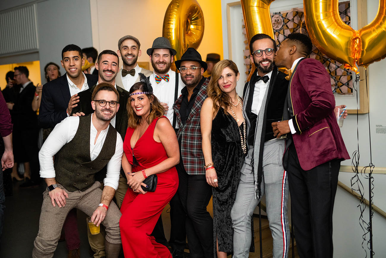 "To celebrate the end of 2018, 21c Museum Hotel threw a new year party on Monday, December 31. The party was called ""Gilded Eve: Confuse Reality with its Replica."" With a 1920s theme, the party featured live music and dancing, a costume contest (awards went to ""best flapper"" and ""most dapper""), and guests were invited to stay the night in the hotel with an upgraded ticket. Understanding New Year's Day can be a rough one for many late partiers, checkout was graciously delayed until 3 PM. A portion of ticket sales benefitted MORTAR, an organization dedicated to helping low-income burgeoning entrepreneurs succeed. / Image: Sam Greenhill, via 21c Museum Hotel // Published: 1.1.19"