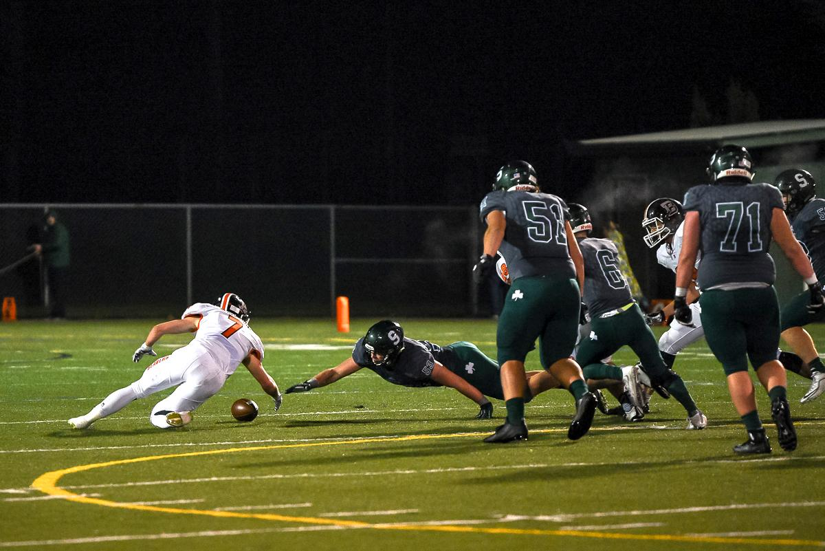 Beaverton linebacker Matthew Eppler (#7) recovers a fumble during Beaverton's 48-7 loss to Sheldon in the first round of the state high school playoffs.  Photo by Jeff Dean Oregon News Lab