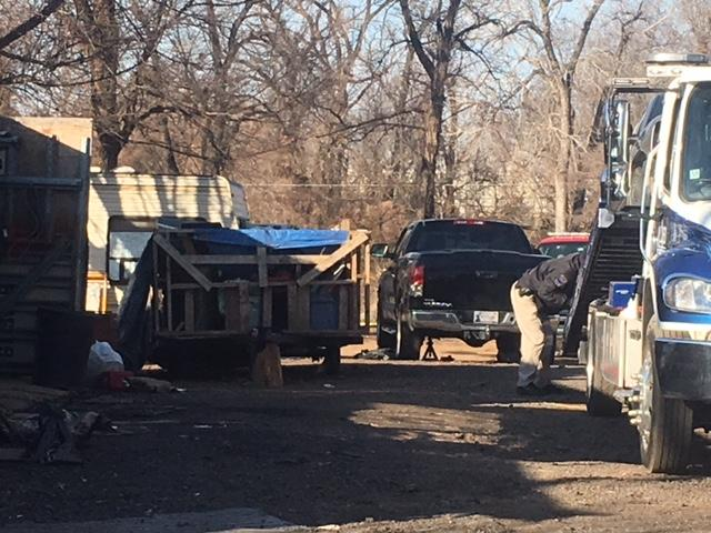 The department's special operations team and auto theft detectives searched a search warrant around 7 a.m. on North Richmond Avenue near Pine and Yale, according to police. (KTUL)