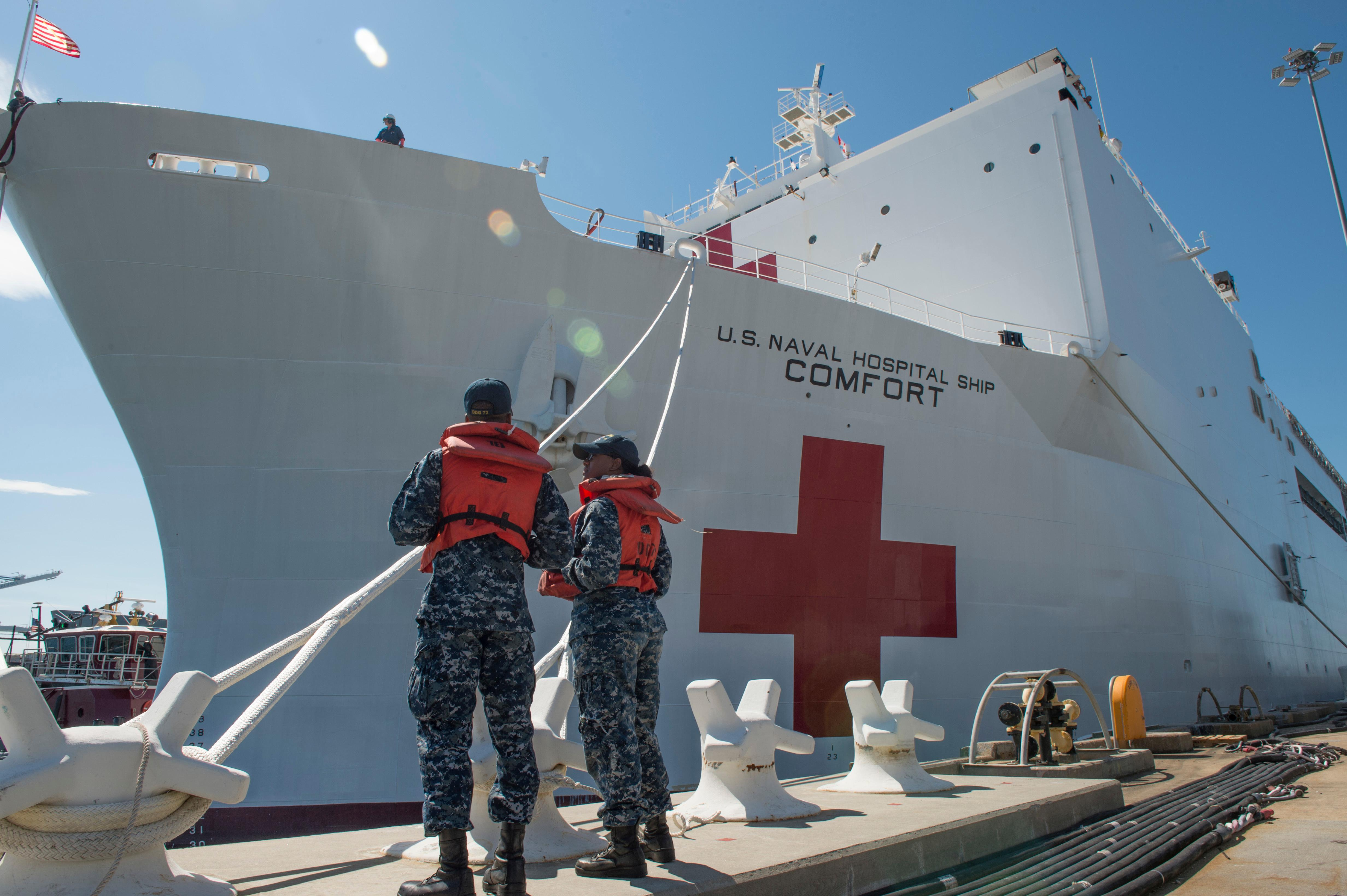 Boatswain's Mate 3rd Class Taryn Armington and Sonar Technician (Surface) Seaman Darian Joseph prepare to cast off mooring lines for the Military Sealift Command hospital ship USNS Comfort (T-AH 20) as the ship departs Naval Station Norfolk to support hurricane relief efforts in Puerto Rico  Friday, Sept. 29, 2017 in Norfolk, Va.. (MC3 Brittany Tobin/U.S. Navy via AP)