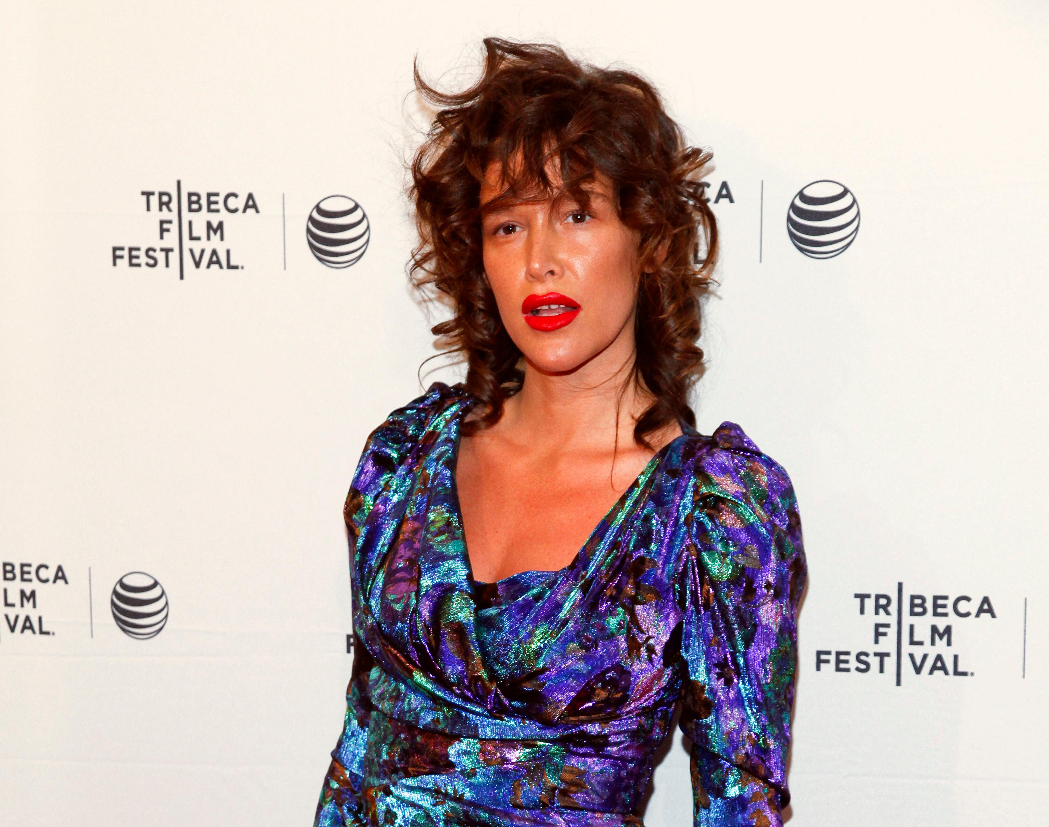 "FILE - In this April 19, 2015 file photo, Paz de la Huerta attends the Tribeca Film Festival world premiere of ""Bare"" at the SVA Theatre in New York. The actress accused Weinstein of raping her two times in 2010 in a CBS News report that aired Thursday, Nov. 2, 2017. The Manhattan district attorney's office confirms it is investigating the claims along with New York police detectives. Weinstein through his spokeswoman has denied de la Huerta's accusations. (Photo by Andy Kropa/Invision/AP, File)"