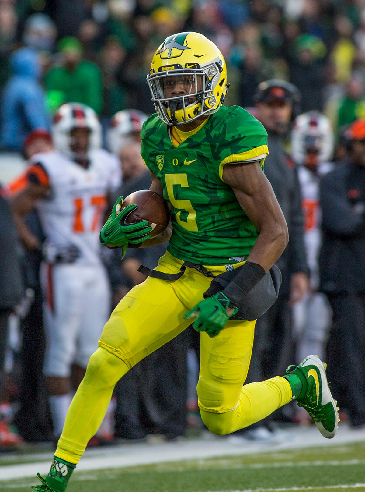 Oregon Ducks Taj Griffin (#5) runs the ball in for a touchdown against the Oregon State Beavers. The Oregon Ducks beat the Oregon State Beavers 52-42 in the 119th Civil War for the eighth year in a row at Autzen Stadium on Friday afternoon. Katie Pietzold, Oregon News Lab