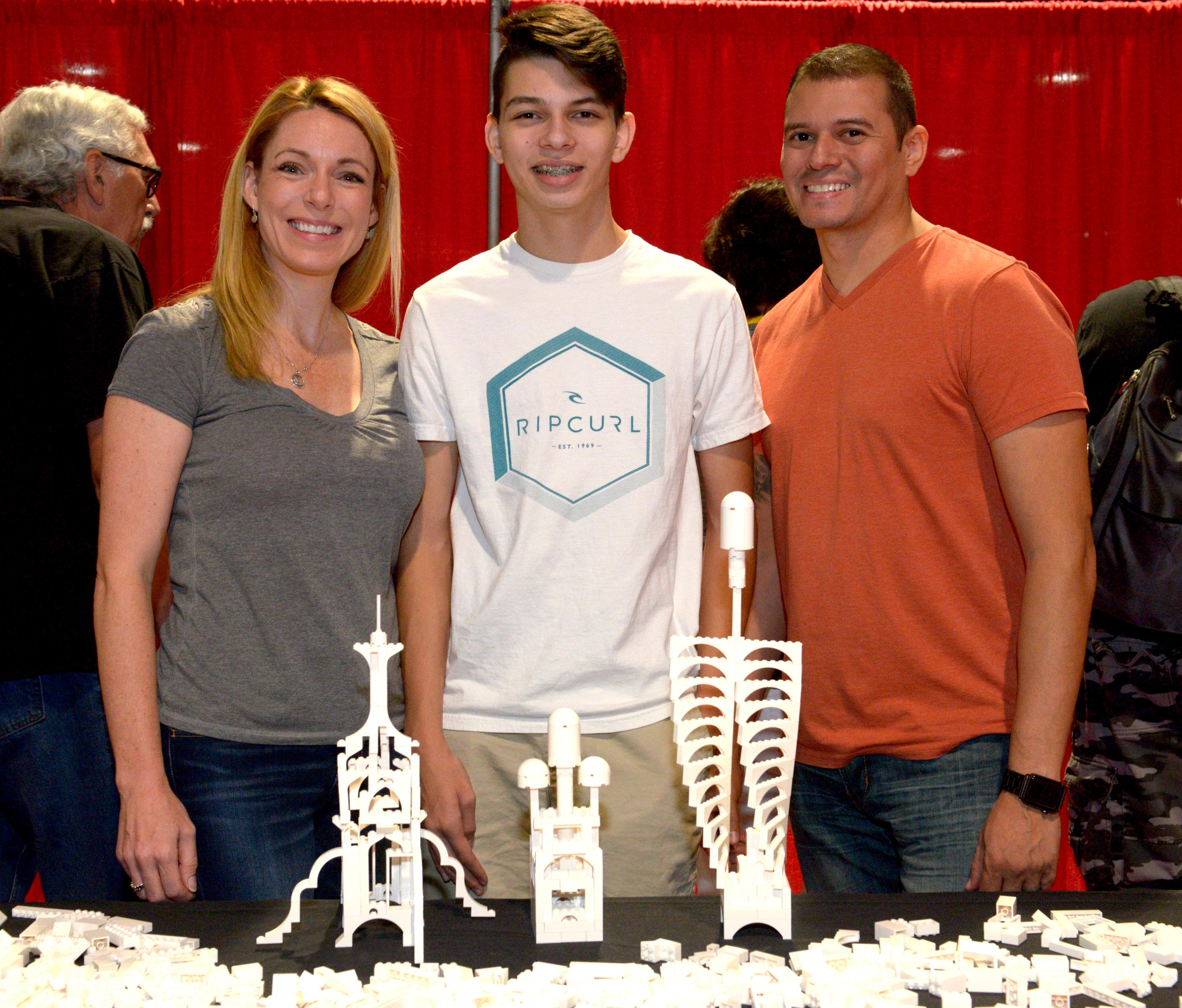 The Bonafe family (l-r) Jamie, Sean and Ben pose with their creations in the Architecture Zone during the Brick Fest Live Lego Fan Experience at the Las Vegas Convention Center, September 9, 2017. [Glenn Pinkerton/Las Vegas News Bureau]
