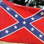 Woman charged after tearing Confederate flag tag off truck, hitting man