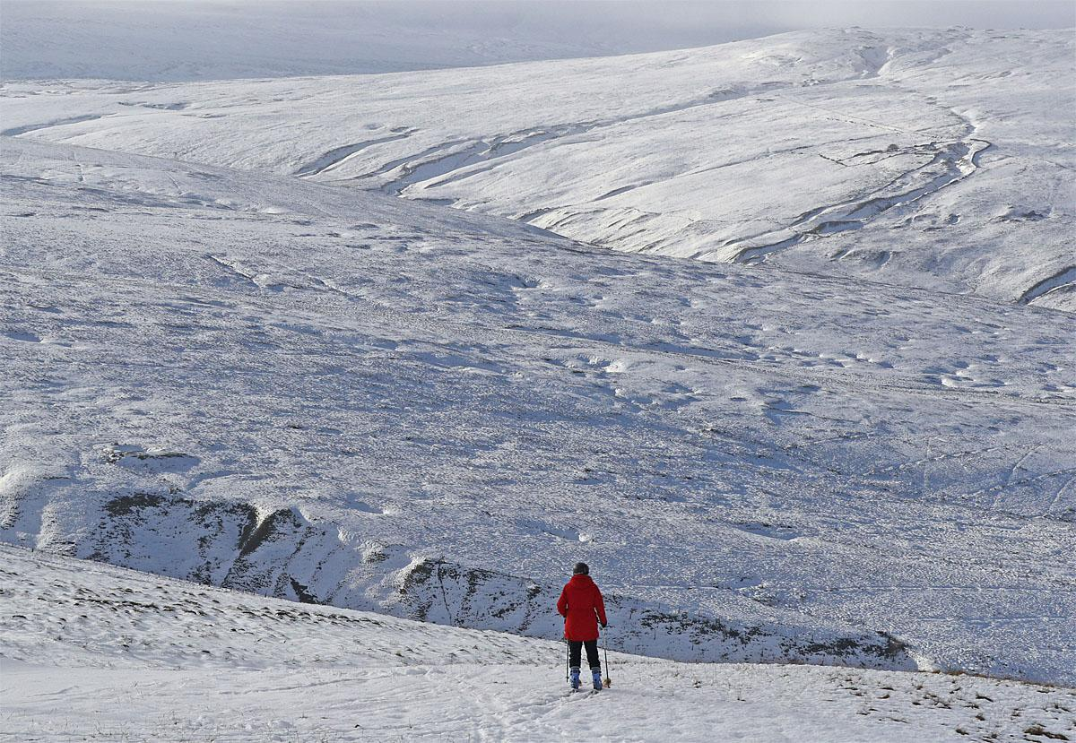 A skier takes to the slopes at Yad Moss ski slope near Alston in the North Pennines, England, on the resort's first day of the skiing and boarding season, Wednesday Nov. 23, 2016. (Owen Humphreys / PA via AP)