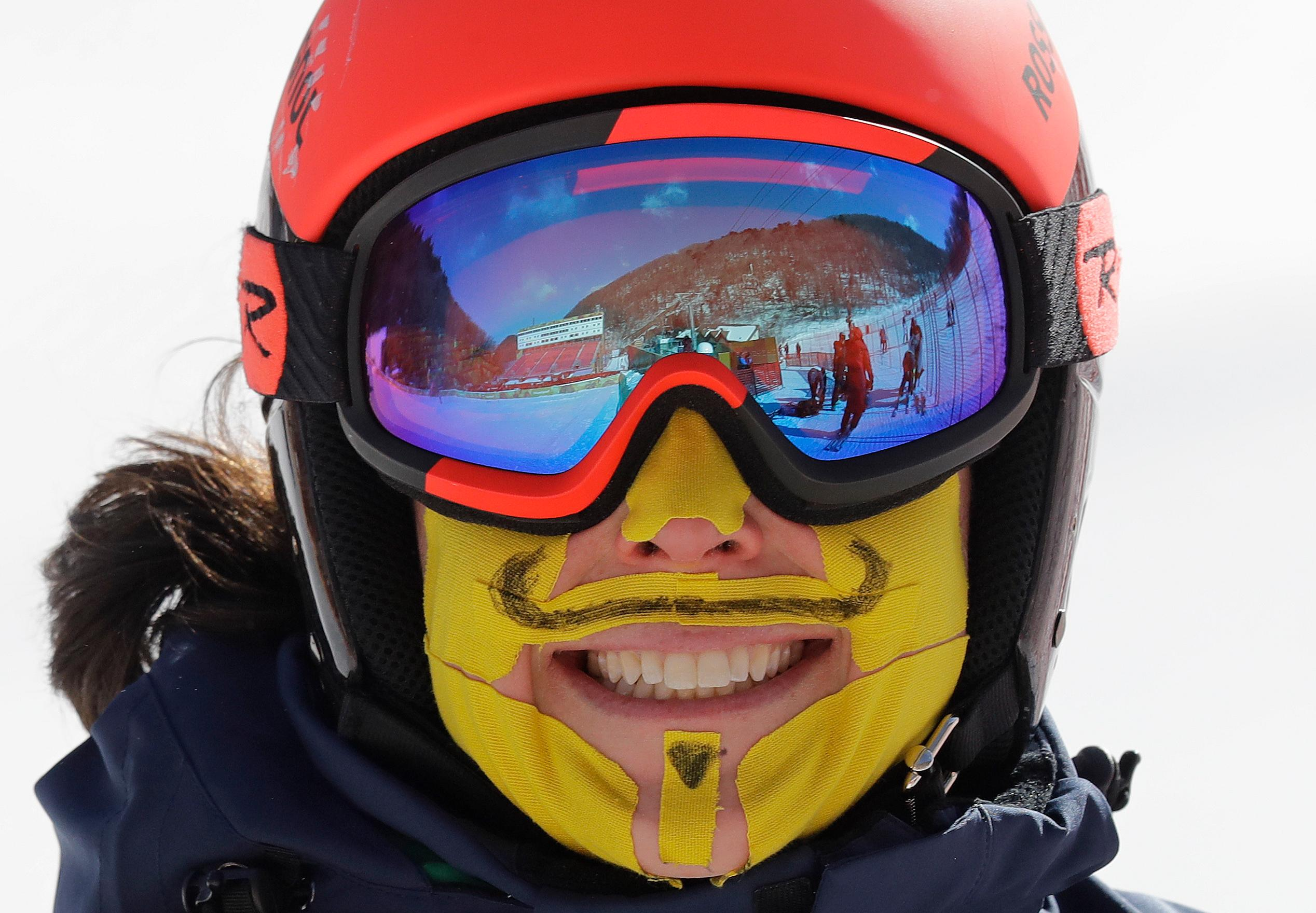 Italy's Federica Brignone has her face covered in tape to protect her from the cold during an inspection of the giant slalom course at the Yongpyong Alpine Center at the 2018 Winter Olympics in Pyeongchang, South Korea, Sunday, Feb. 11, 2018. (AP Photo/Michael Probst)