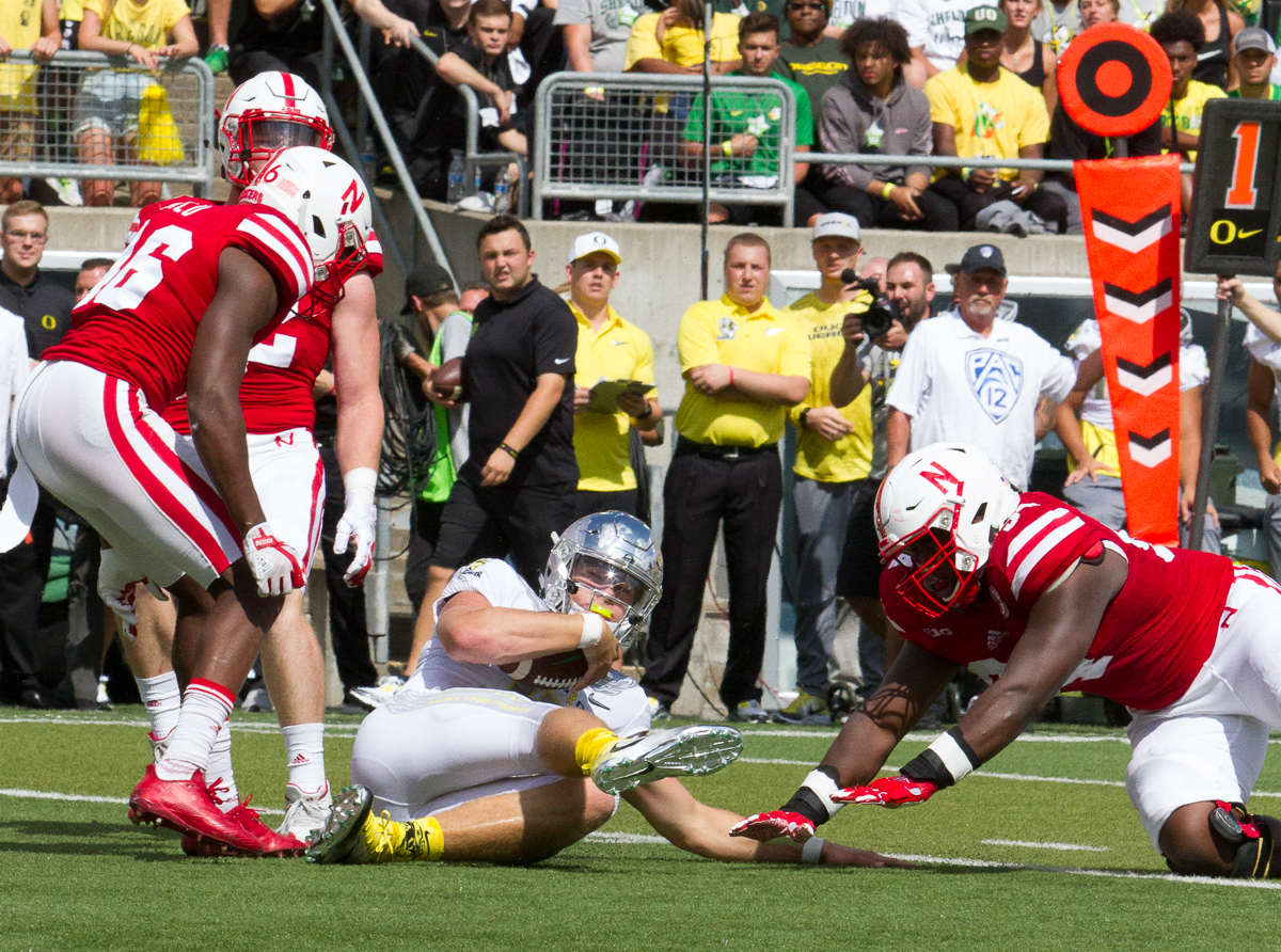 Oregon quarterback Justin Herbert (#10) slides across the turf after a run. The Oregon Ducks lead the Nebraska Cornhuskers 42 to 14 at the end of the first half on Saturday, September 9, 2017. Photo by Ben Lonergan, Oregon News Lab