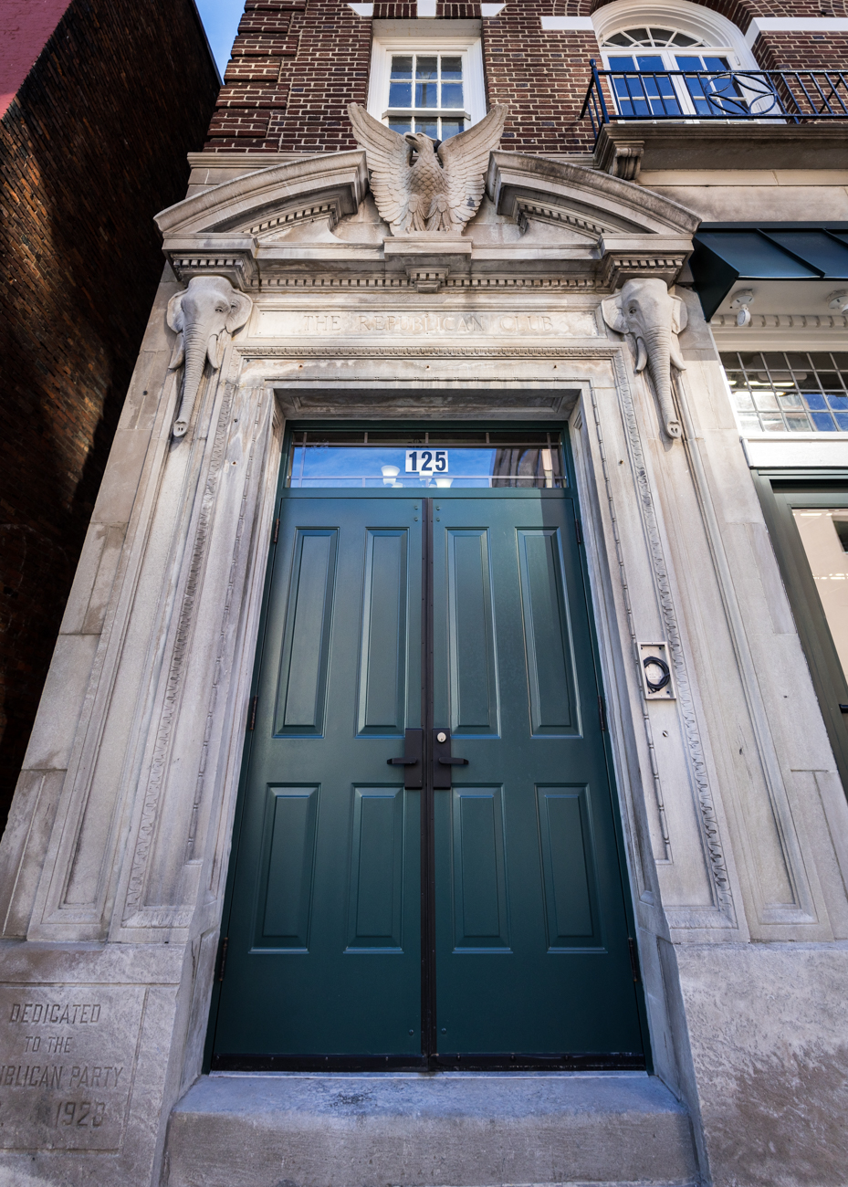 On the facade of the building, beautiful stone elephants adorn either side of a doorway. / Image courtesy of Hub+Weber Architects PLC (via Phil Armstrong) // Published: 2.10.17