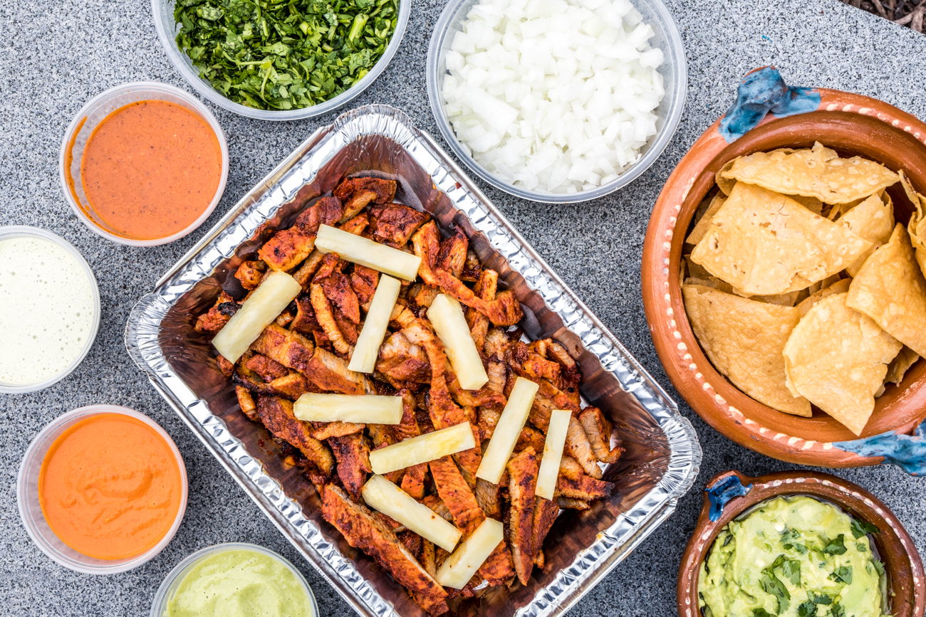 They partnered with Rhinegeist and The Takeaway Deli and Grocery to create the Fiesta Taco Kit. It features a six-pack of Cheetah with the kit that includes 10 corn tortillas, a pound of one or two choices of protein (al pastor, bistec, or mushrooms), house salsas, onions, cilantro, and limes. It feeds four to five people. Pictured is the al pastor Fiesta Taco Kit. / Image: Catherine Viox // Published: 5.22.20