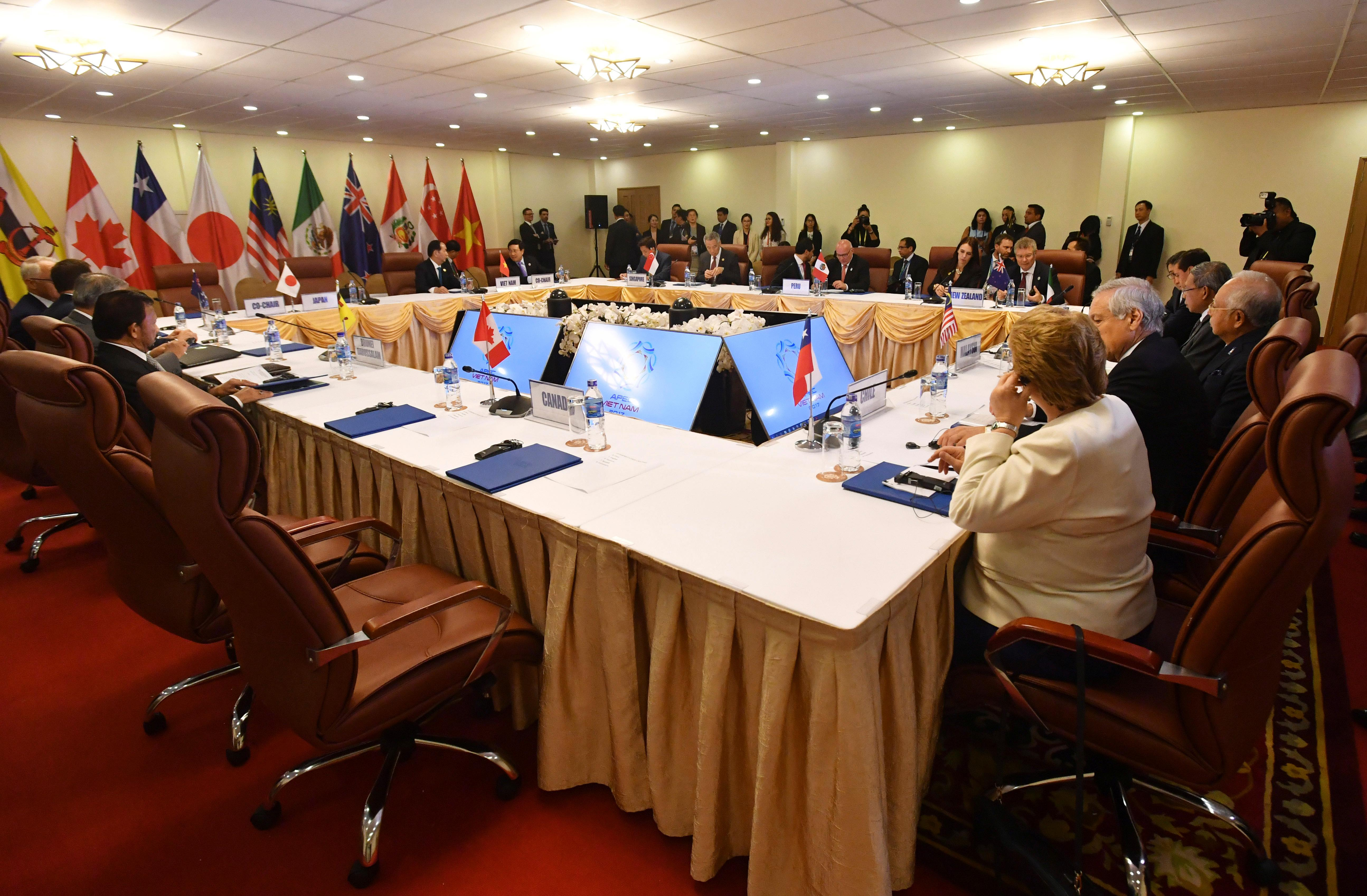 The empty seat, foreground, for Canada's Prime Minister Justin Trudeau, is seen during a meeting of the Trans-Pacific Partnership (TPP) on the sidelines of the Asia-Pacific Economic Cooperation (APEC) summit in Danang, Vietnam, Friday, Friday, Nov. 10, 2017. (Mick Tsikas/AAP Image via AP)