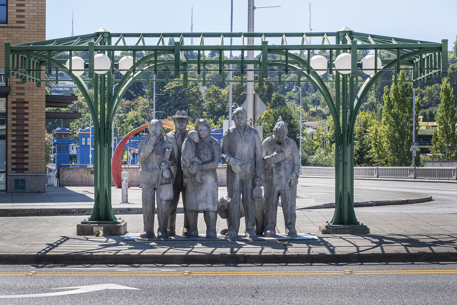 These commuters have been patiently awaiting transit for decades. Standing at the corner of North 34th Street in Fremont, the full-size cast aluminum group sculpture was created in 1979 by sculptor Richard Beyer to commemorate the light rail line that once connected downtown Seattle to other neighborhoods. (Image: Rachael Jones / Seattle Refined)<p></p>