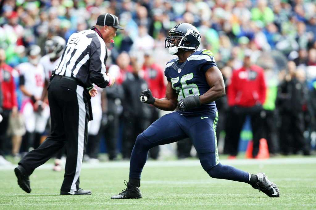 Seahawks defensive lineman Cliff Avril celebrates after sacking Falcons quarterback Matt Ryan in the first half of Seattle's game against Atlanta, Sunday Oct. 16, 2016, at CenturyLink Field. (Photo: Genna Martin, Seattlepi.com)