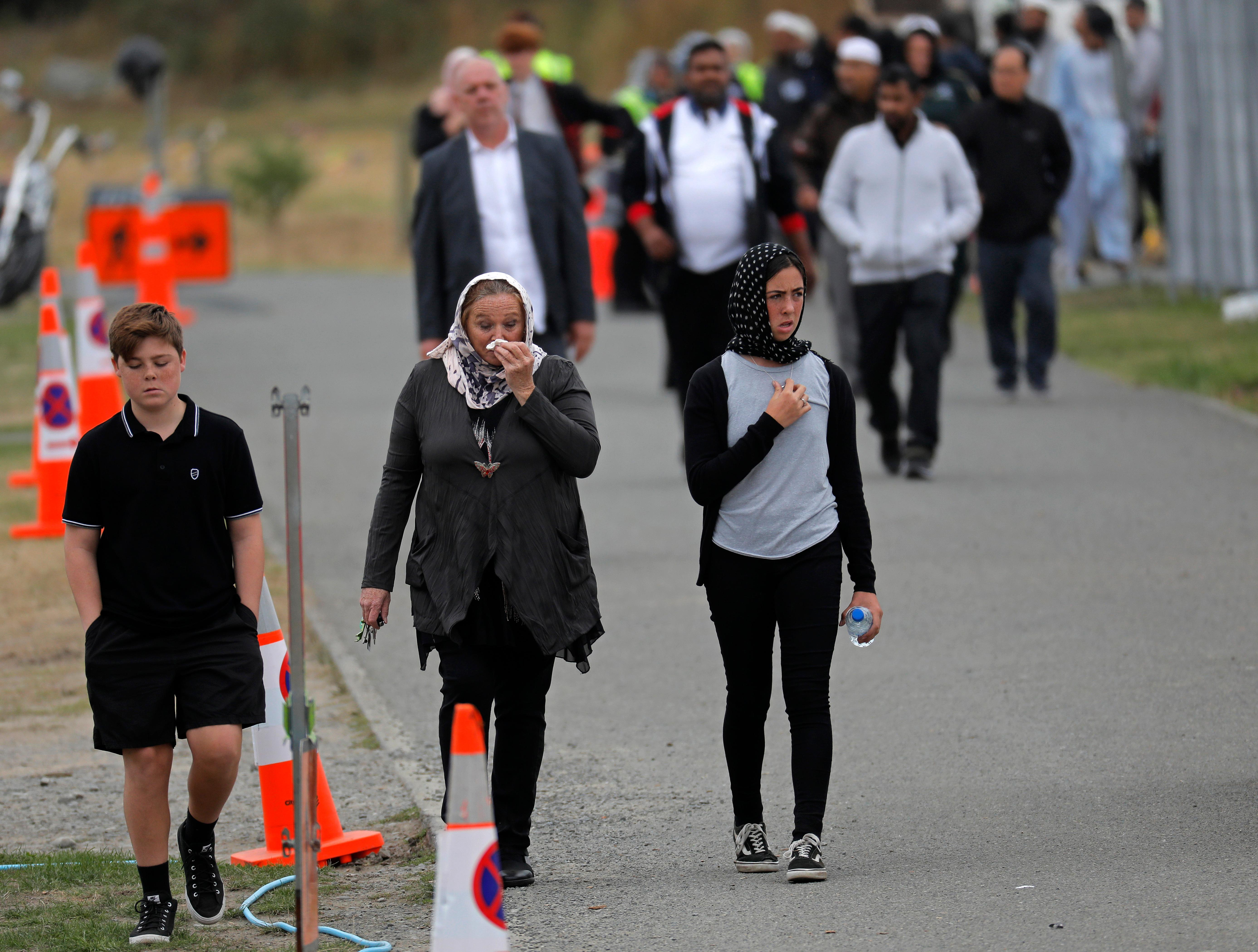 Mourners leave the cemetery after the burial service of a victim of the Friday March 15 mosque shootings at the Memorial Park Cemetery in Christchurch, New Zealand, Thursday, March 21, 2019. (AP Photo/Vincent Yu)