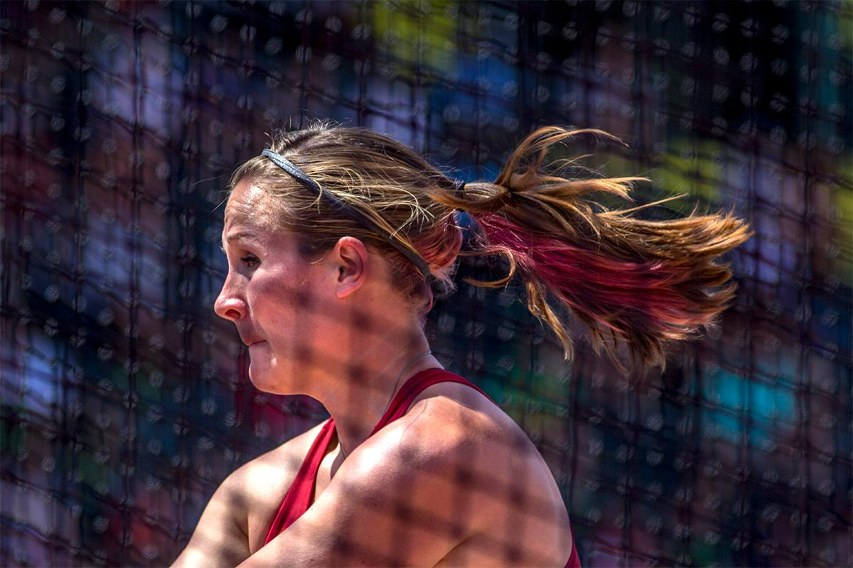 Oklahoma's Julia Reedy went with a red strip of hair to match her uniform while competing in the hammer throw. Photo by August Frank, Oregon News Lab