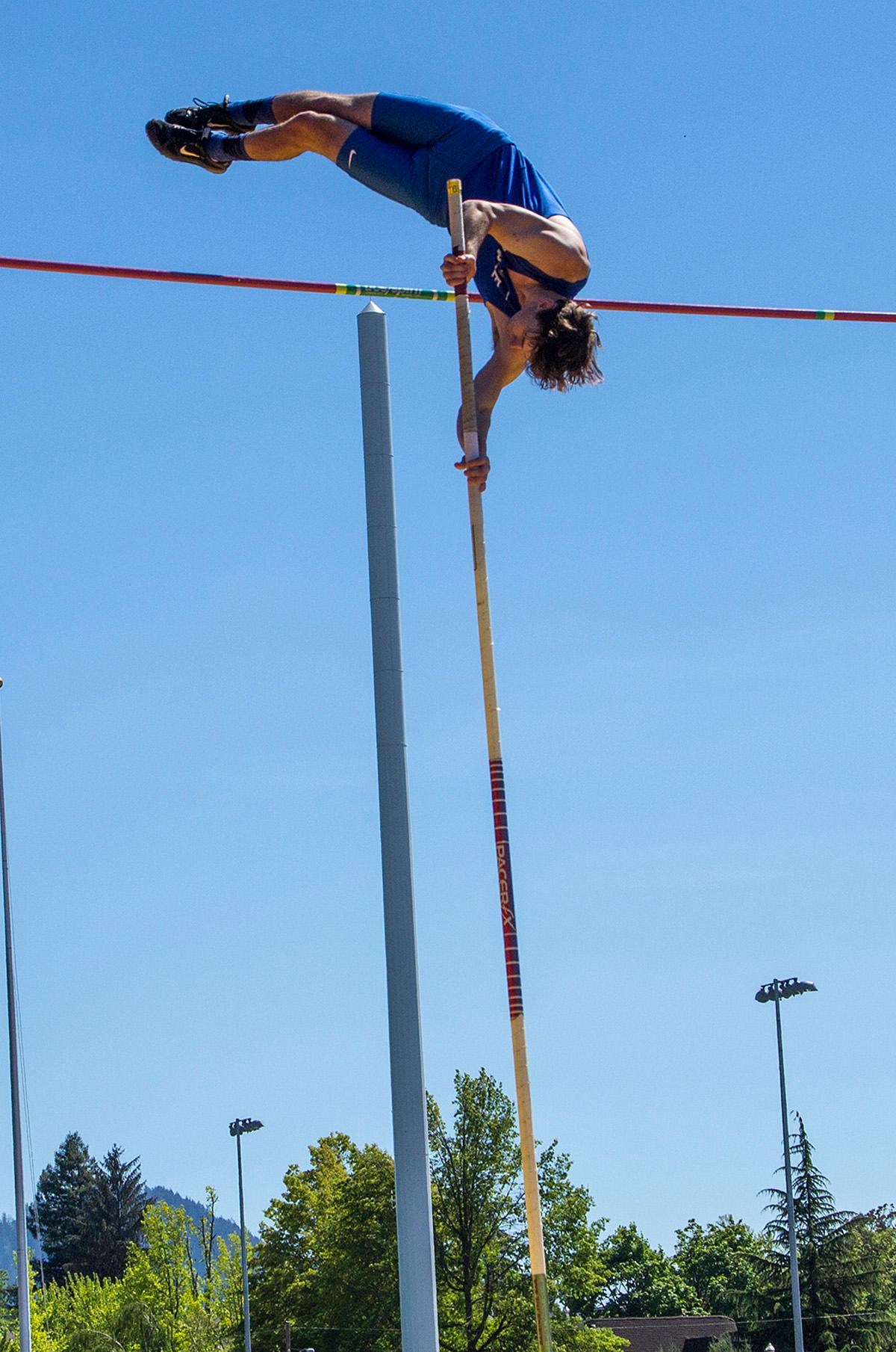 An athlete participates in the Boys Pole Vault 5A at the OSAA Track and Field State Championships at Hayward Field. Photo by Nichole Louchios, Oregon News Lab.