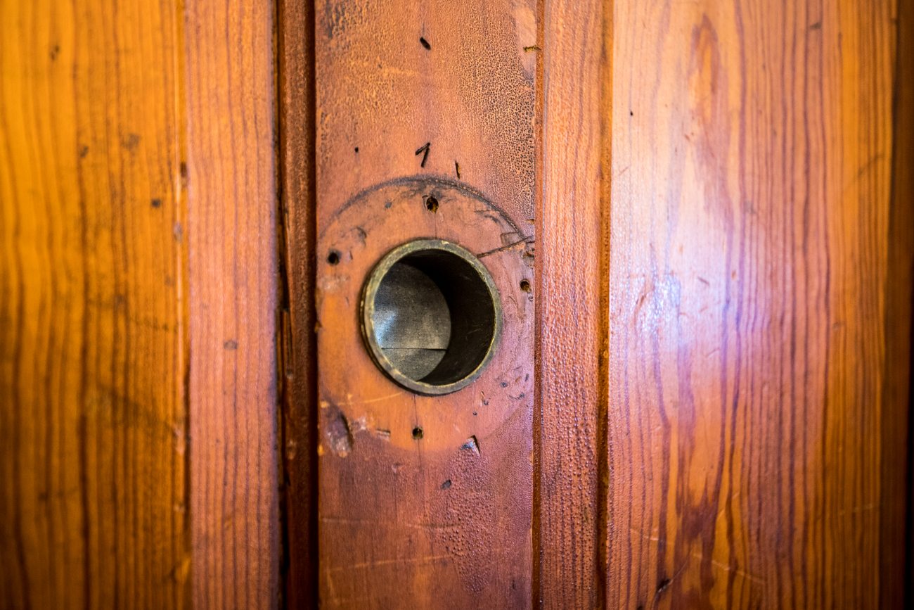 An original brass peep hole in the door to The Ballroom / Image: Catherine Viox{ }// Published: 9.19.20
