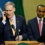 Governor's ringing phone interrupts his news conference