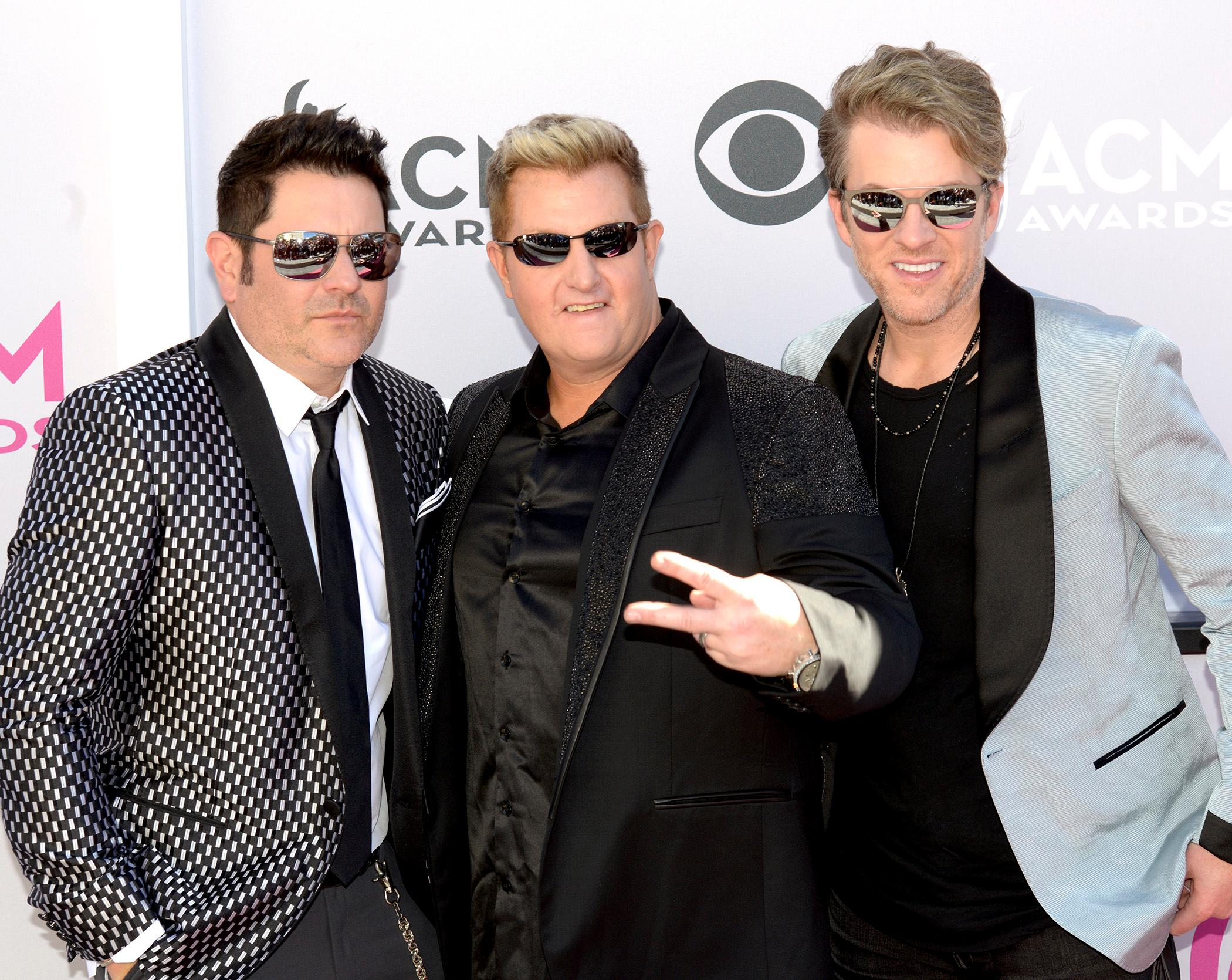 (left to right) Jay DeMarcus, Gary LeVox and Joe Don Rooney, also known as Rascal Flatts and nominee for Vocal Group of the Year walk the Academy of Country Music Awards red carpet at T-Mobile Arena. Sunday, April 2, 2017. (Glenn Pinkerton/ Las Vegas News Bureau)