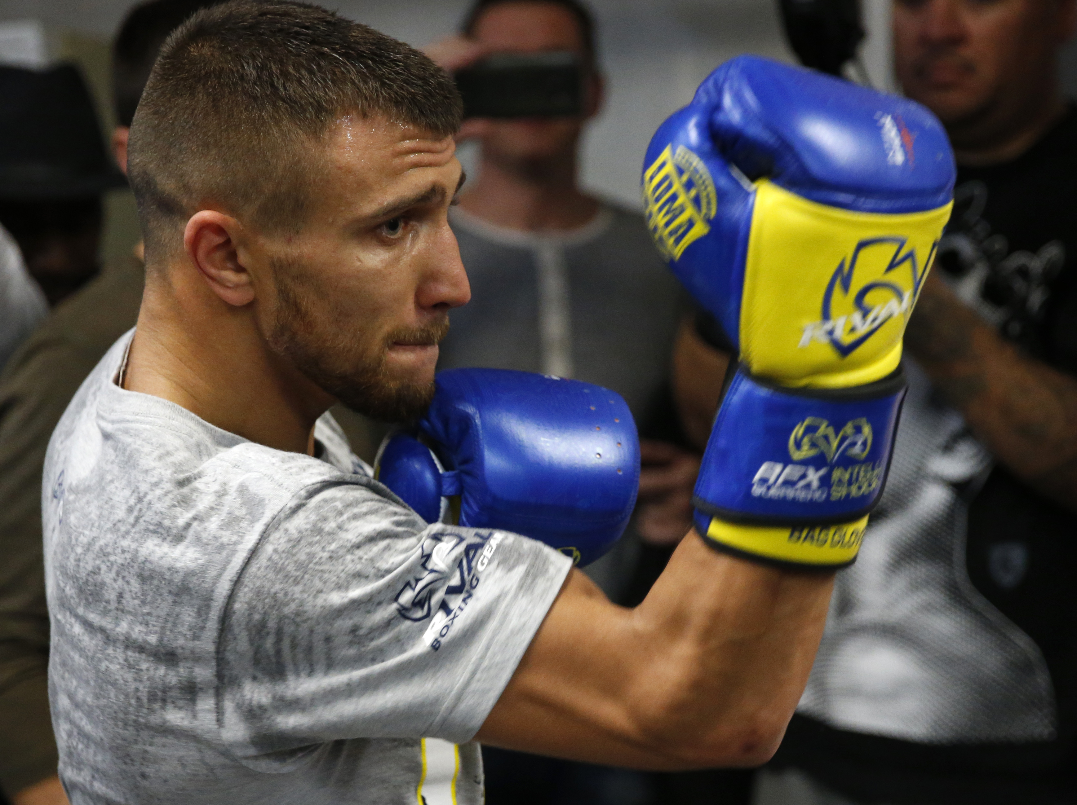 Vasyl Lomachenko, of Ukraine, punches a bag Wednesday, Dec. 6, 2017, during a workout at a Manhattan boxing gym in New York, for Saturday's WBO super featherweight title fight against Cuban defector Guillermo Rigondeaux, 37. The fight, said to pit two of boxing's pound-for-pound best technical fighters, will be held at Madison Square Garden. (AP Photo/Kathy Willens)
