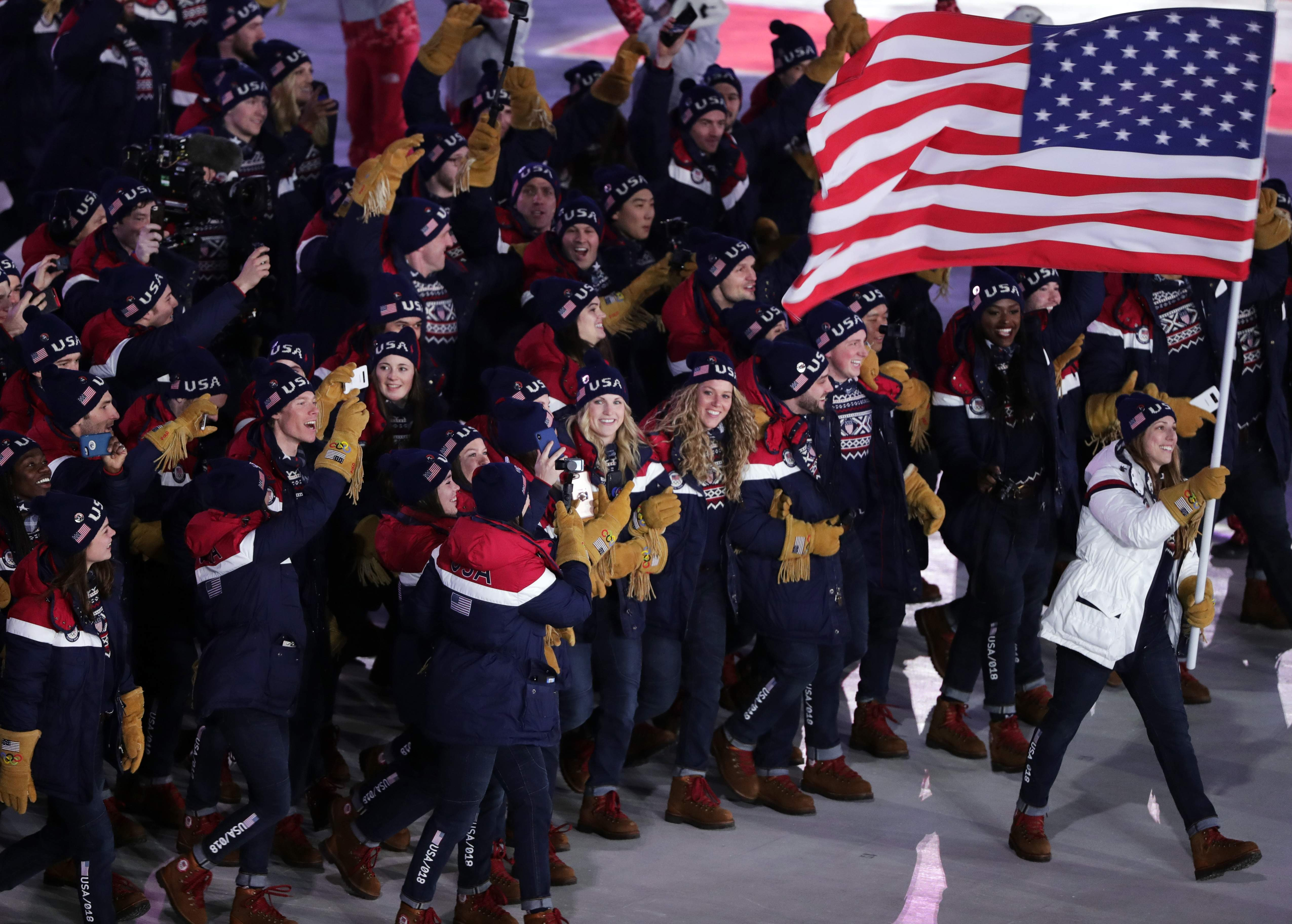 Erin Hamlin carries the flag of the United States during the opening ceremony of the 2018 Winter Olympics in Pyeongchang, South Korea, Friday, Feb. 9, 2018. (AP Photo/Julie Jacobson)