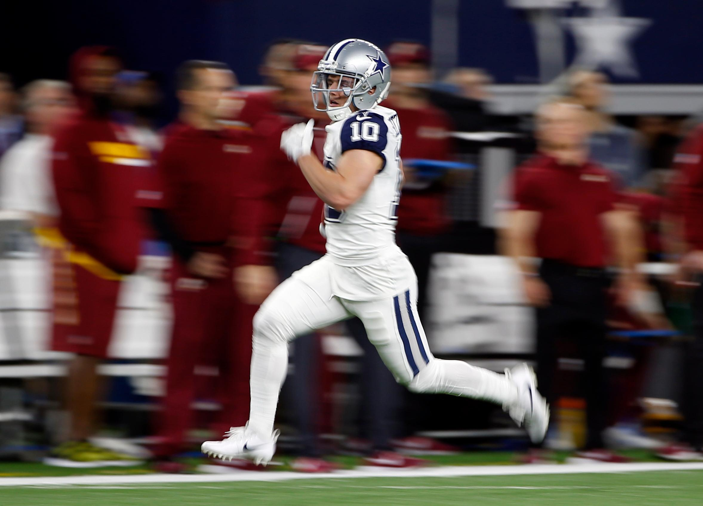Dallas Cowboys wide receiver Ryan Switzer (10) returns a Washington Redskins punt for a touchdown in the first half of an NFL football game, Thursday, Nov. 30, 2017, in Arlington, Texas. (AP Photo/Ron Jenkins)