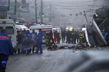 Experts, firefighters and police officers examine a site of a trolleybus explosion in Volgograd, Russia Monday, Dec. 30, 2013. A bomb blast tore through the trolleybus in the city of Volgograd on Monday morning, killing at least 10 people.