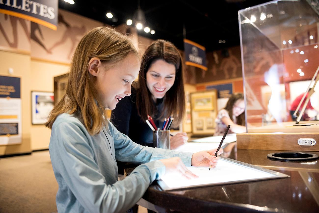 Families get involved with interactive art displays within the museum's National Art Museum of Sport. Select pieces are displayed from a collection of nearly 1,000 works. / Image courtesy of Children's Museum of Indianapolis // Published: 4.2.19