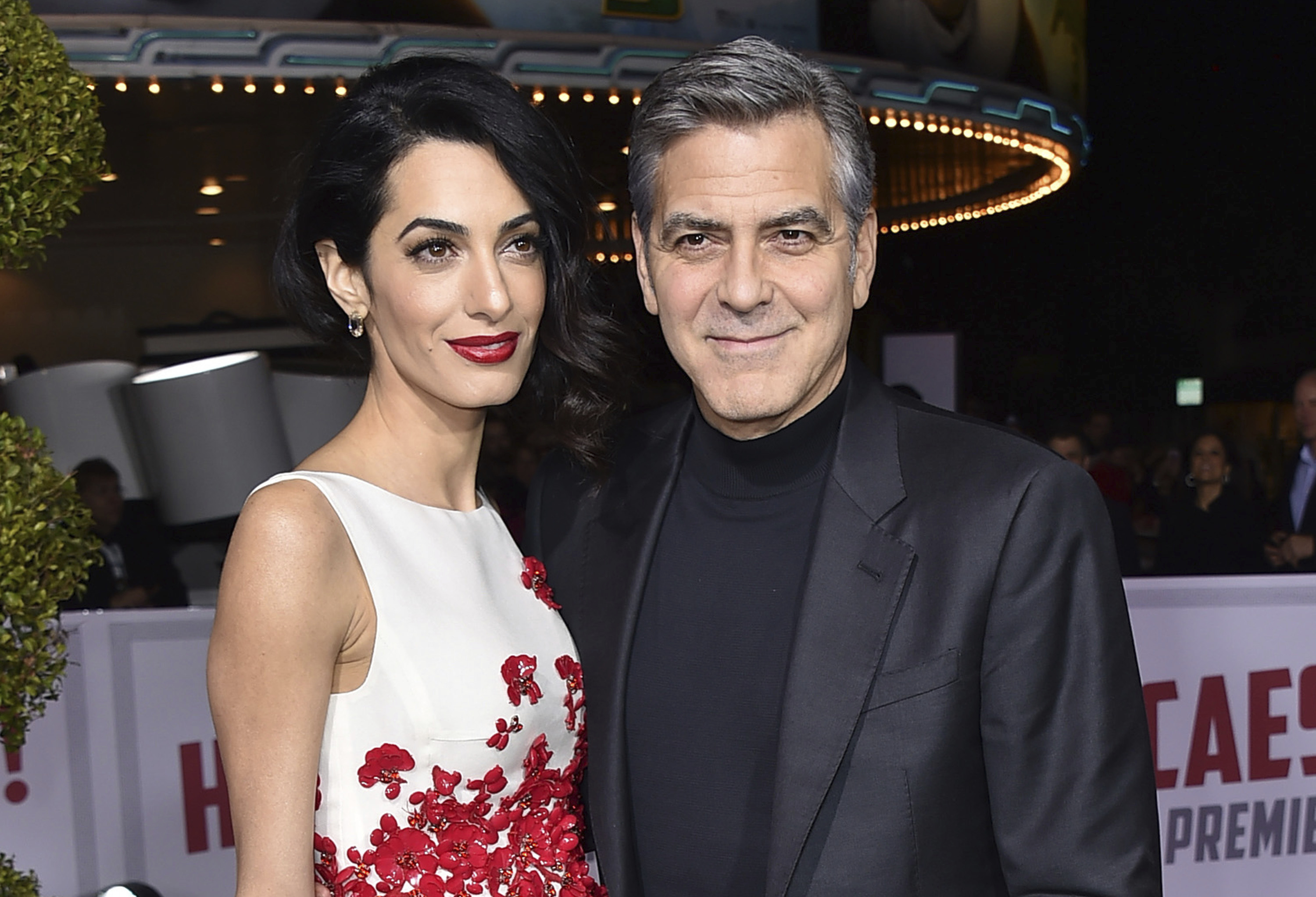 "FILE - In this Feb. 1, 2016 file photo, Amal Clooney, left, and George Clooney arrive at the world premiere of ""Hail, Caesar!"" in Los Angeles.  George and Amal Clooney have welcomed twins Ella and Alexander Clooney. The pair was born Tuesday morning, June 6, 2017, according to George Clooney's publicist Stan Rosenfield.  (Photo by Jordan Strauss/Invision/AP, File)"