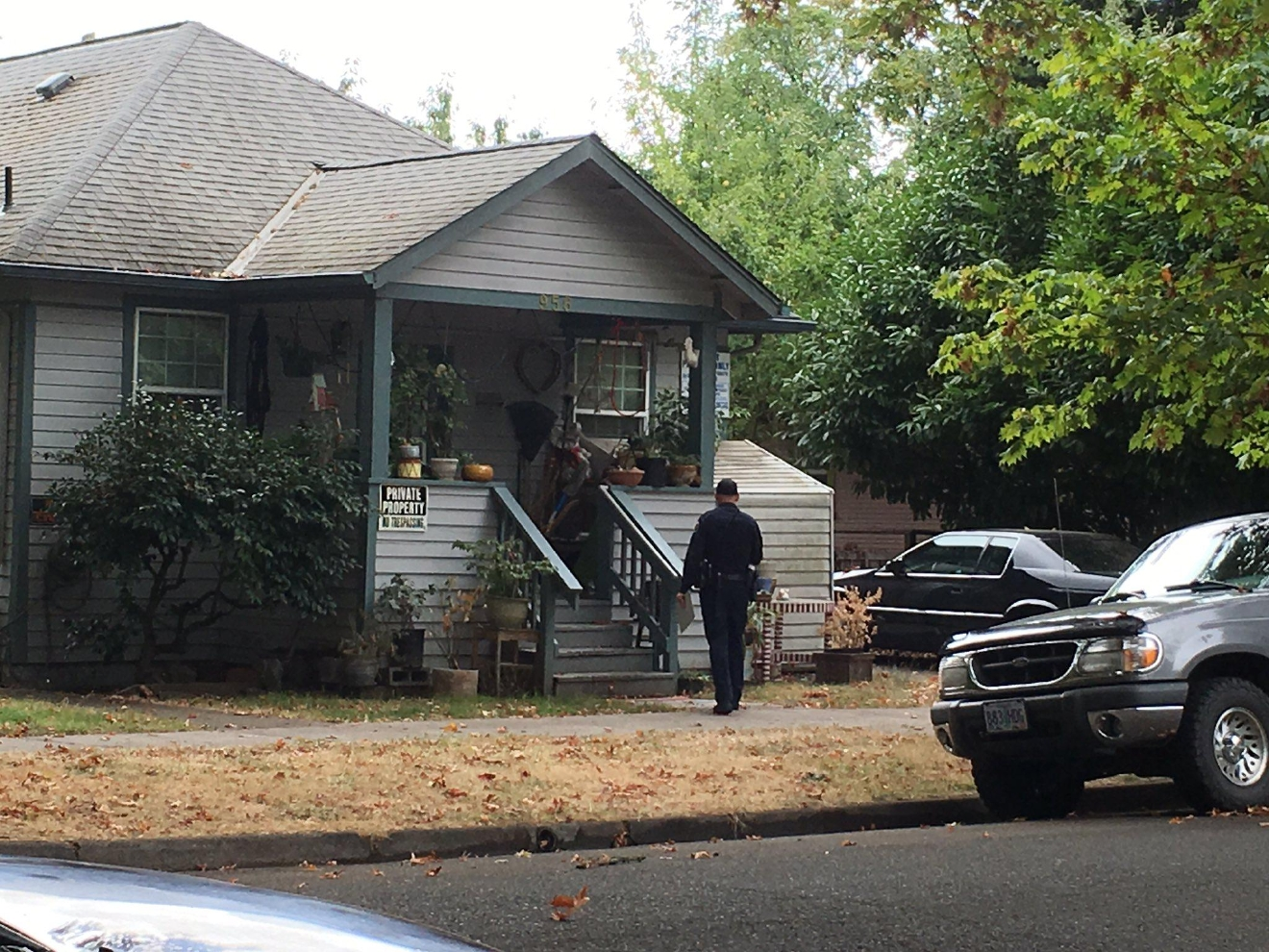 Eugene Police officers went door-to-door Tuesday searching for any witnesses, photos or videos from the night Anthony Xavier Johnson was killed in the Whiteaker neighborhood. (SBG photo)