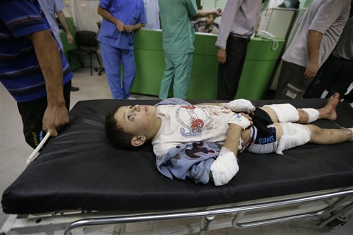 A 12-year-old Palestinian boy, wounded in an Israeli strike in Jebaliya refugee camp, in the northern Gaza Strip, is wheeled into the emergency room of the Kamal Adwan hospital.