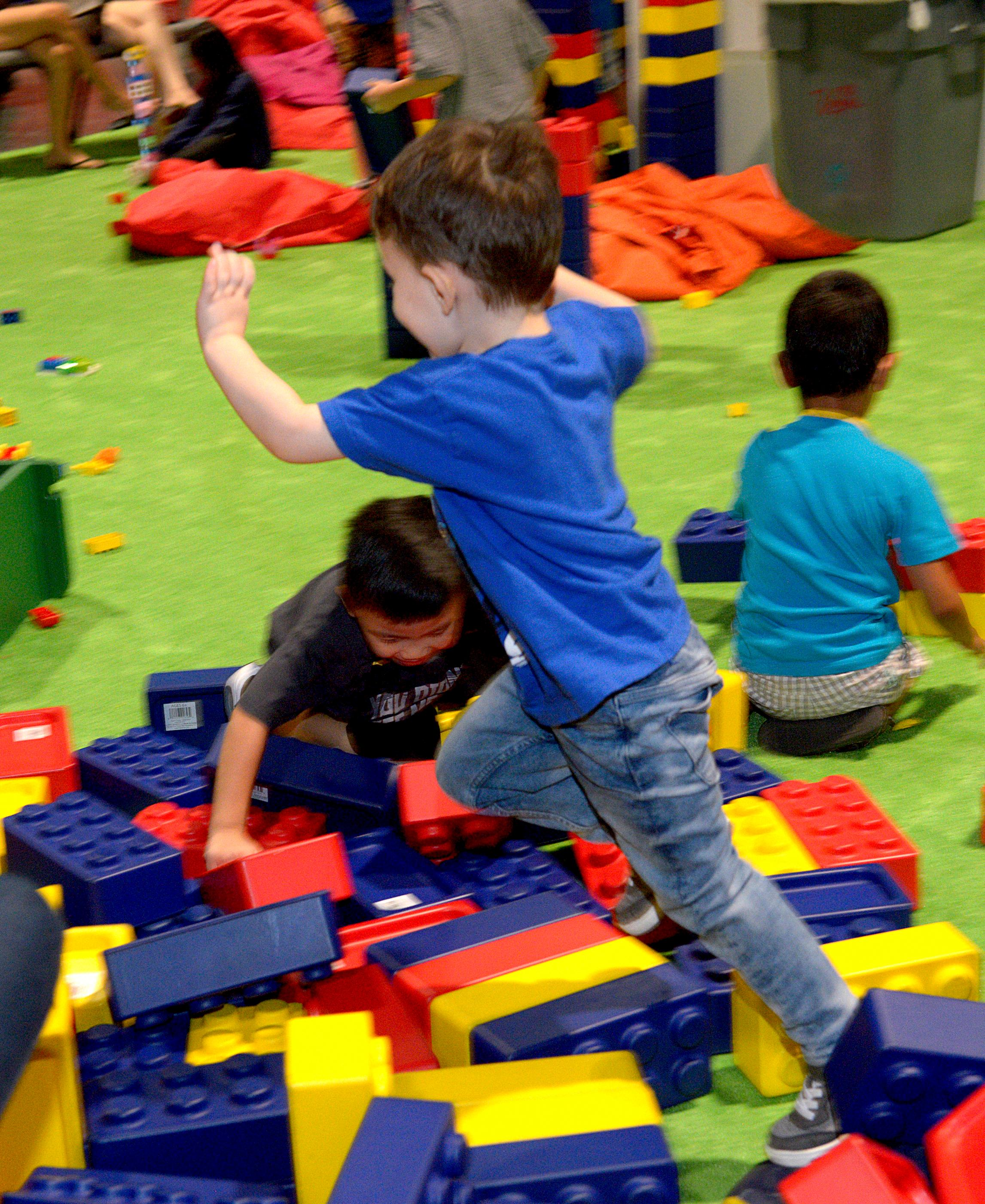 3 Year old Noah Olszeiwski leaps into a pile of rubber Legos during the Brick Fest Live Lego Fan Experience at the Las Vegas Convention Center, September 9, 2017. [Glenn Pinkerton/Las Vegas News Bureau]