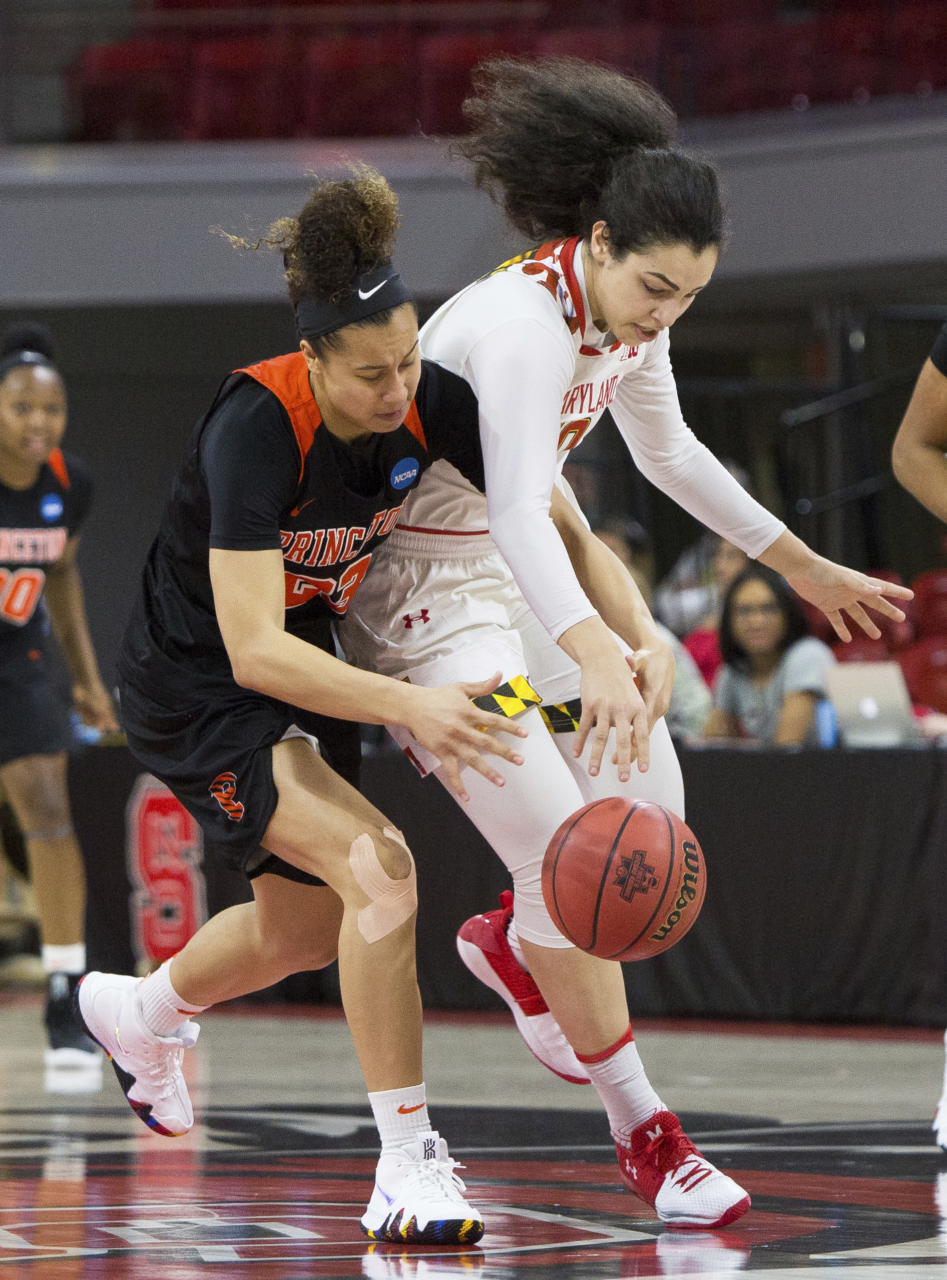 Maryland's Eleanna Christinaki, right, reaches for a steal against Princeton's Qalea Ismail, left, during the first half of a first-round game in the NCAA women's college basketball tournament in Raleigh, N.C., Friday, March 16, 2018. (AP Photo/Ben McKeown)