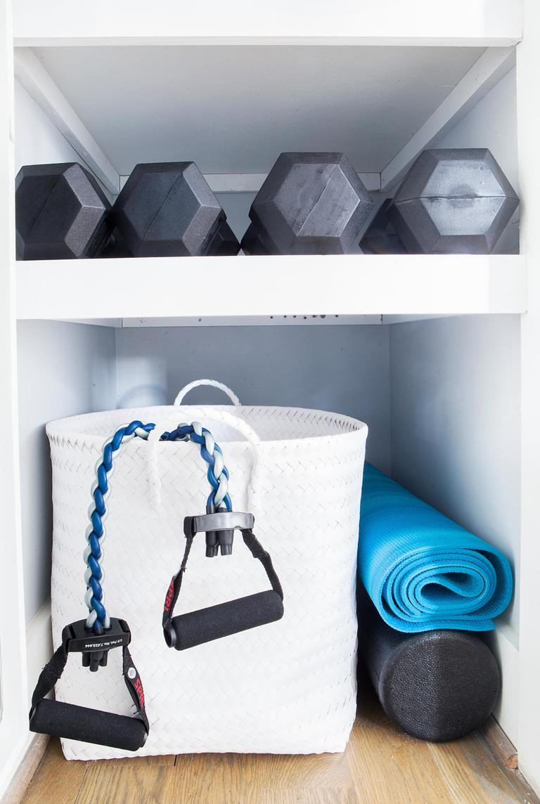 8. Accessorize: Add all the bells and whistles such as a tie holder, full length mirror, belt and hat hooks, basket storage for socks, work out gear, brief cases, etc. (Image: Ashley Hafstead)