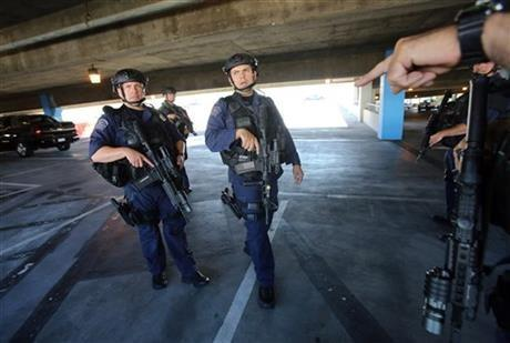 SWAT officers search a parking structure during a security check at Los Angeles International Airport on Friday Nov. 1, 2013.