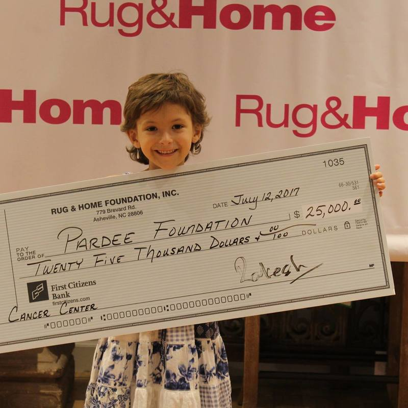 Rug & Home donates thousands to Pardee