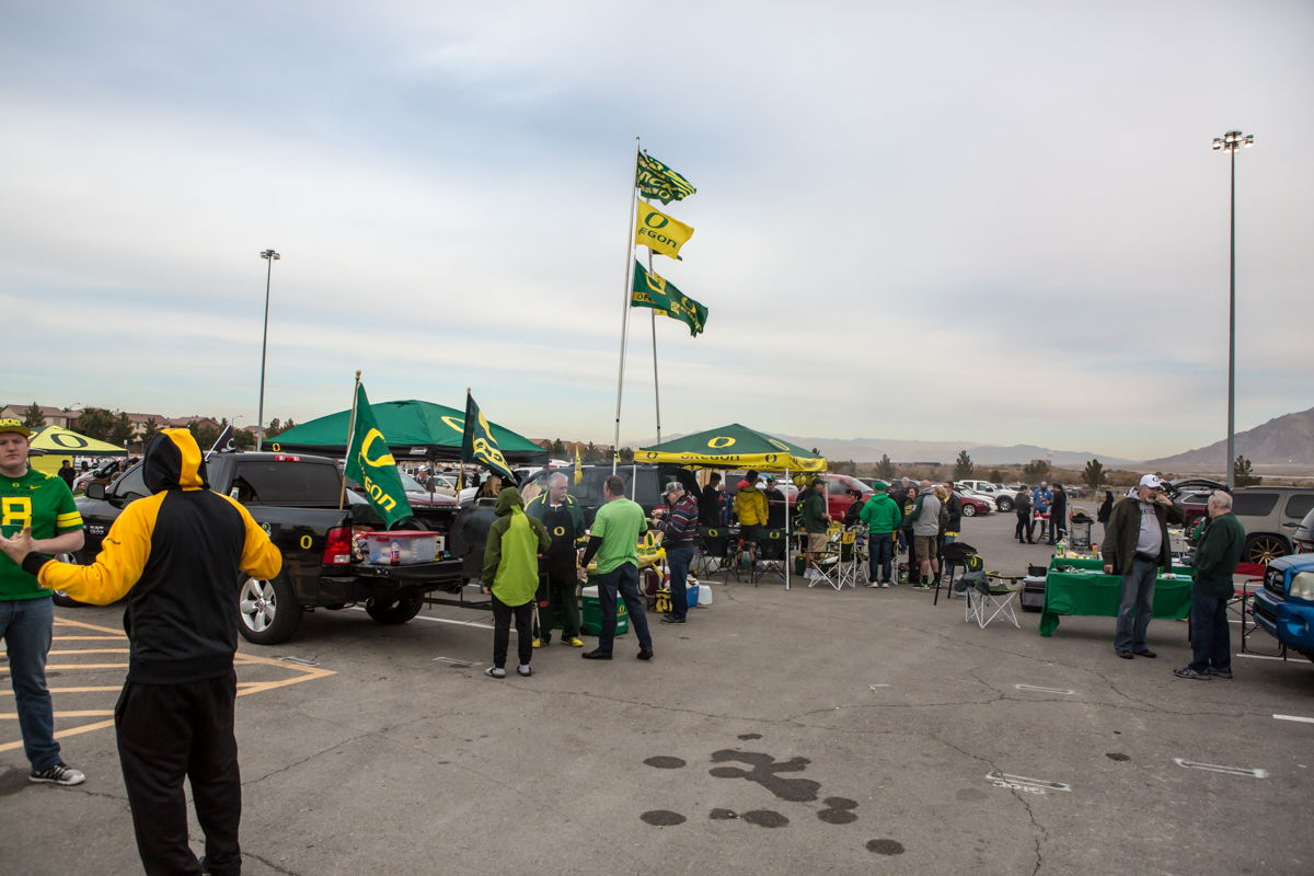 Oregon fans tailgate before the game at Sam Boyd Stadium. The Oregon Ducks trail the Boise State Broncos 14 to 24 at the end of the first half of the Las Vegas Bowl at Sam Boyd Stadium in Las Vegas, Nevada. Photo by Ben Lonergan, Oregon News Lab