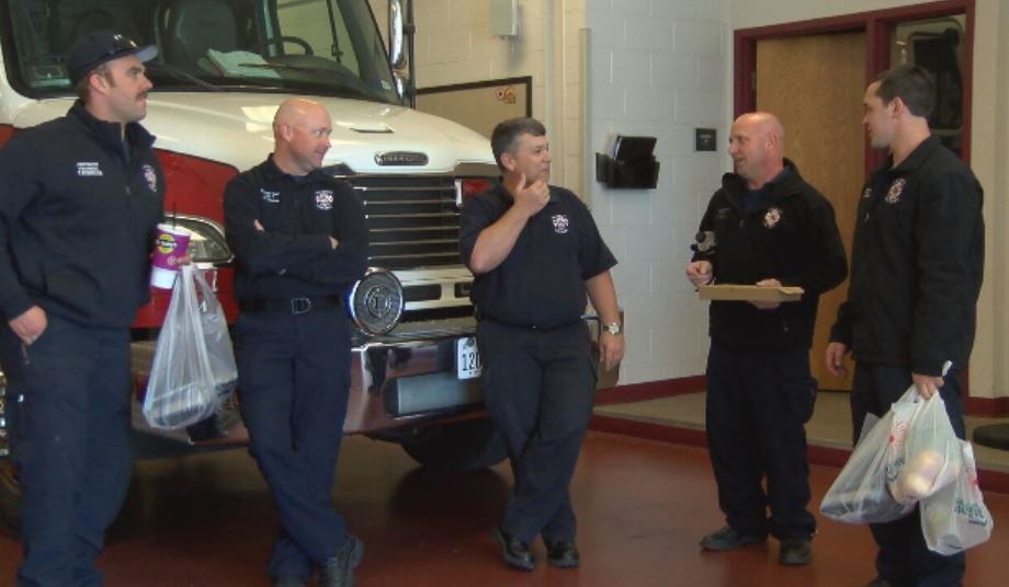 Amarillo Fire Department District Chief Phillip Thomas (second from left) visits with the crew of AFD's Central Station. (Kase Wilbanks/ABC 7 Amarillo)