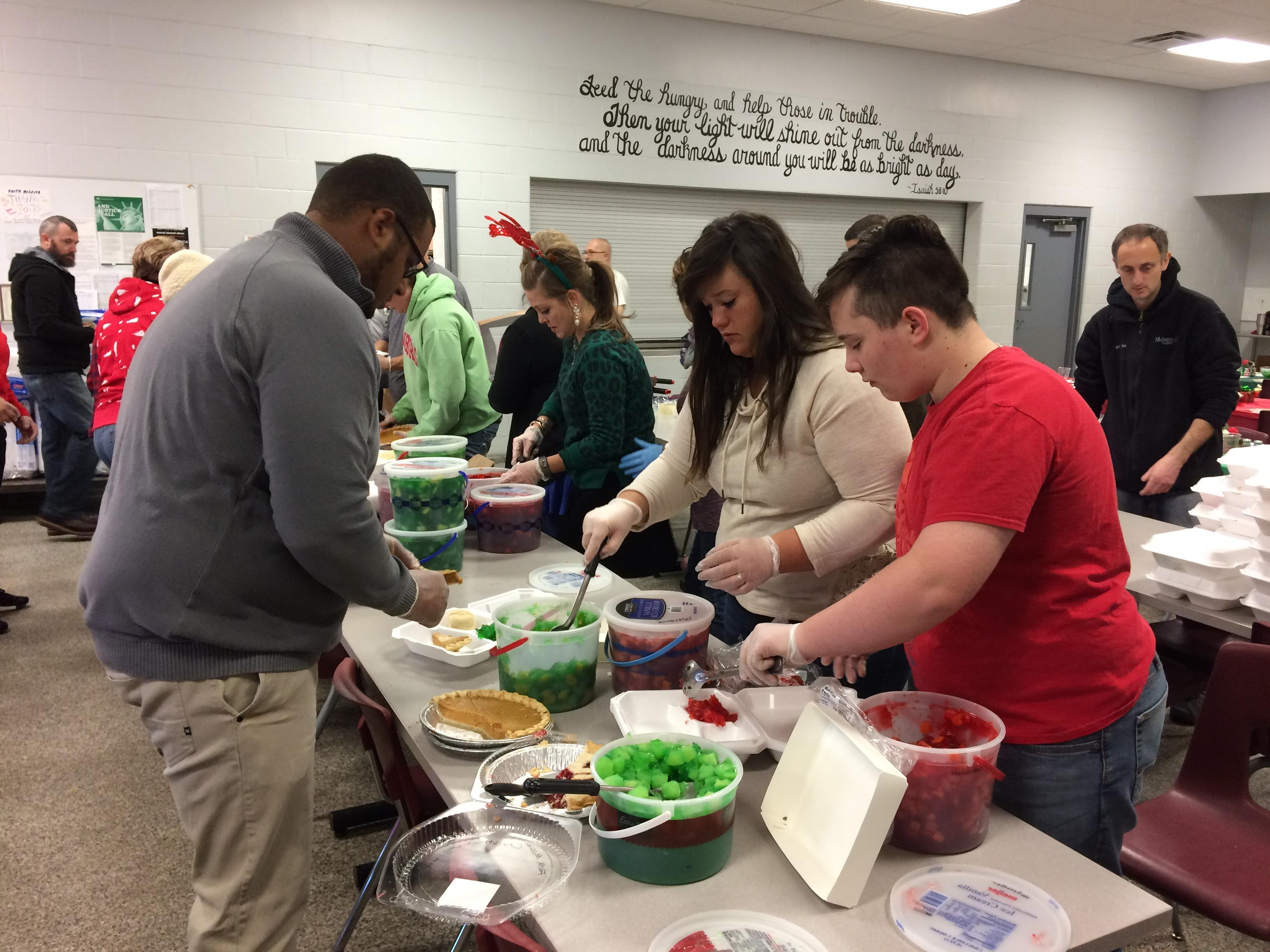 Elkhart volunteers prepare 450 holiday meals for needy. // WSBT 22