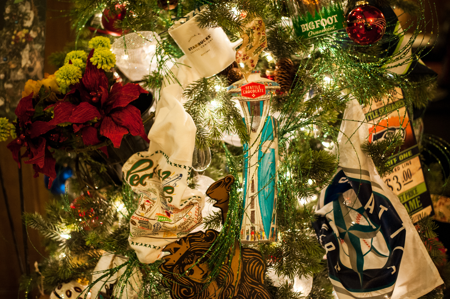 <p>Seattle Greetings- 7.5 feet tall, a tree filled with iconic Seattle memorabilia.. Located in the Fairmont Olympic Hotel in downtown Seattle, the annual Festival of Trees has officially kicked off this holiday season. Patrons can view the trees on display through December 2, 2018 - or bid on them for their home/office. Proceeds benefit Seattle Children's Hospital. (Image: Elizabeth Crook / Seattle Refined)</p>