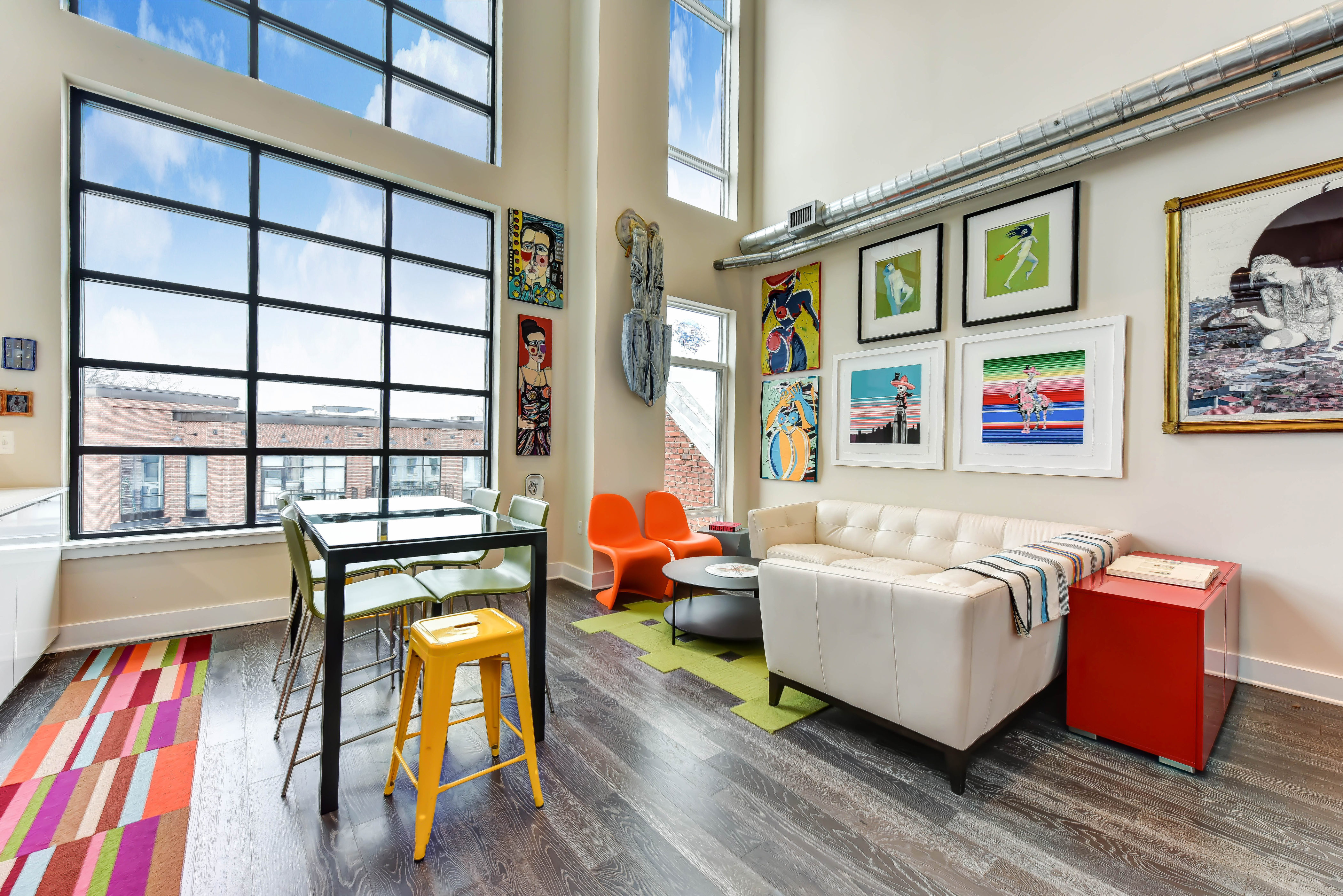 This dual-level, loft-style penthouse is the last unit available in a boutique six-unit building. The two-bedroom, two-bath 1,000-square-foot condo has an industrial chic vibe with exposed ductwork, a sliding barn door and floor-to-ceiling windows. It's been on the market for seven days, starting at $769,000. (Image: Courtesy Compass)
