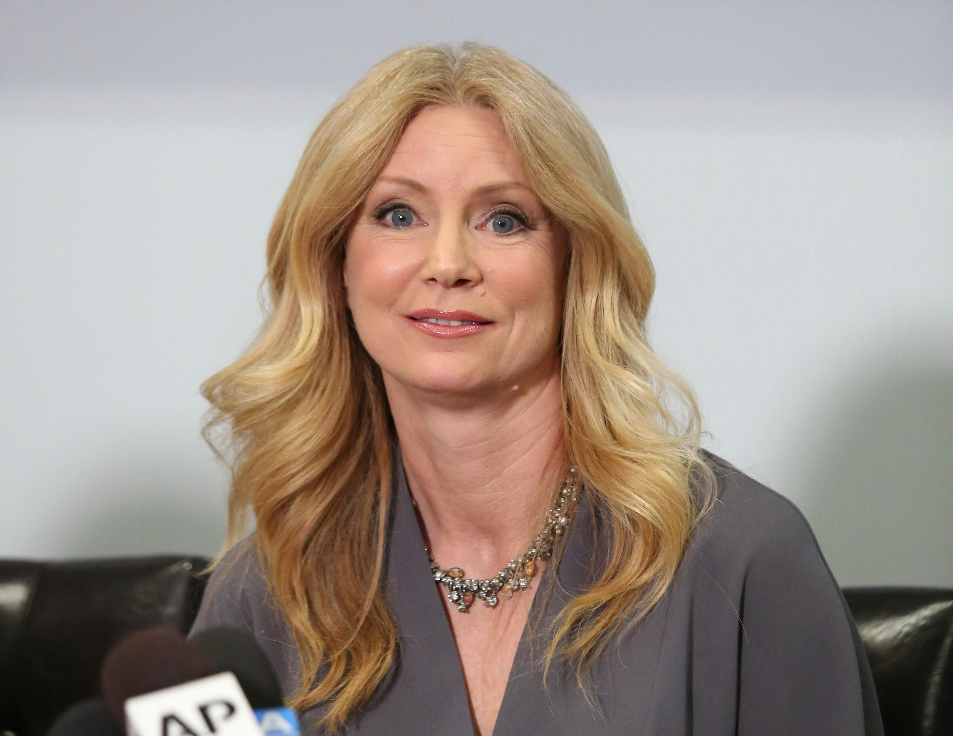 "Former Fox News contributor Wendy Walsh appears at a news conference in the Woodland Hills section of Los Angeles on Monday, April 3, 2017.  Walsh says she lost a segment on ""The O'Reilly Factor"" after she refused to go to host Bill O'Reilly's bedroom following a 2013 dinner in Los Angeles. She's seeking an investigation by New York City's Commission on Human Rights. (AP Photo/Anthony McCartney)"