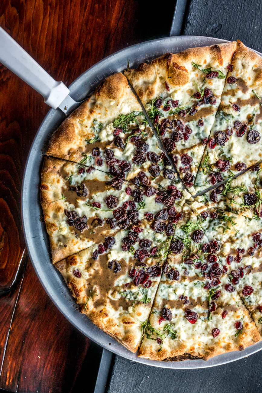 Arugula Pizza: garlic and olive oil base, dried cherries, goat cheese, arugula, and balsamic drizzle / Image: Catherine Viox // Published: 2.3.20