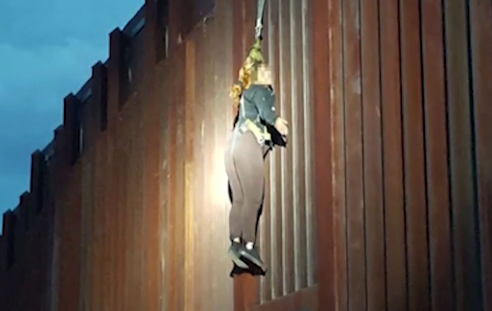 Smugglers attempting to cross Arizona's border with Mexico left a woman dangling from a fence, officials said. (Photo: CNN Newsource)